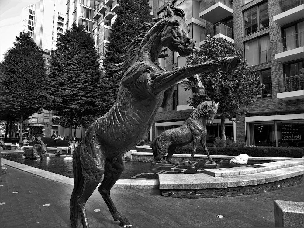 Grayscale Photo of Horse Staue