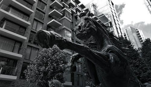 Grayscale Photo of Concrete Horse Statue