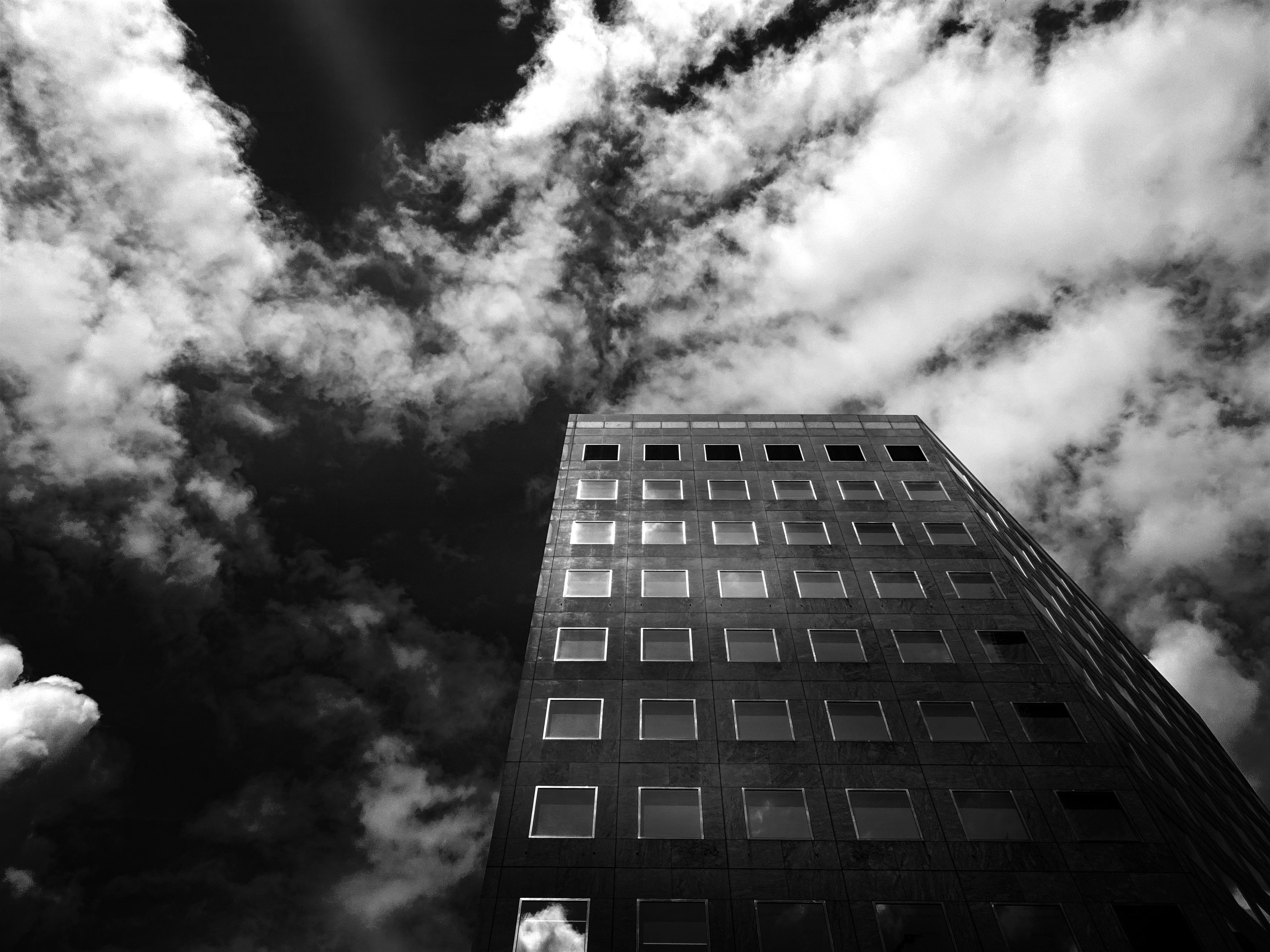 Low-angle Photography of Concrete High-rise Building Under Cloudy Skies