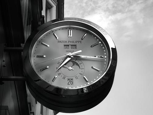Gray Patek Philippe Clock Displaying 7:16