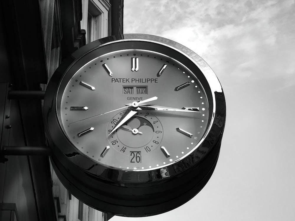 Gray Patek Philippe Clock Displaying 7:16