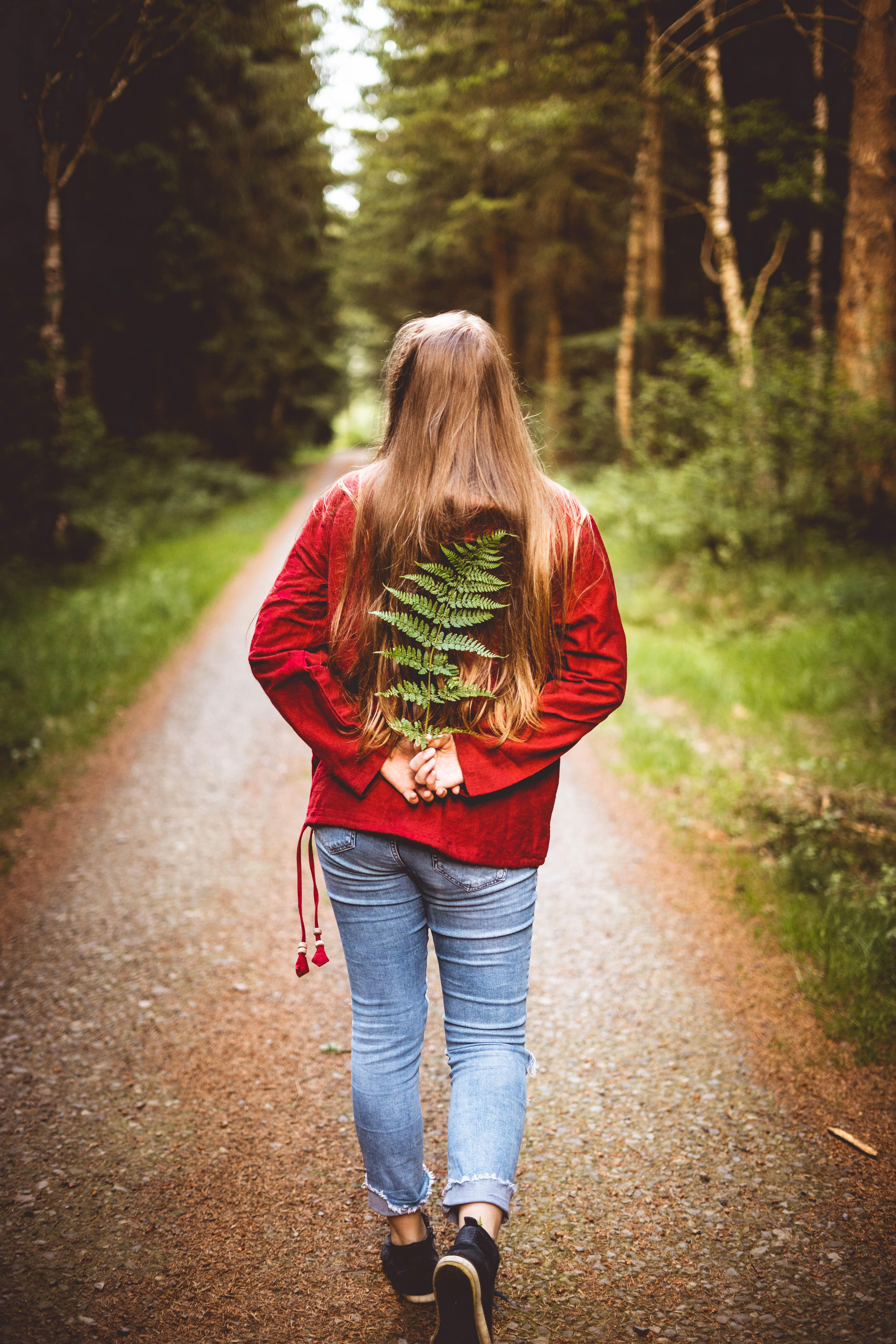 Woman Holding Leaves on Her Back