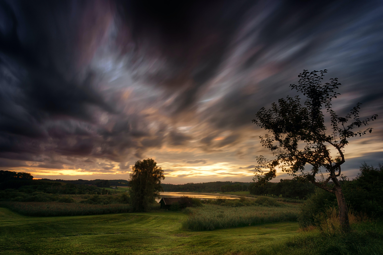 Green Grass Field With Dark Sky