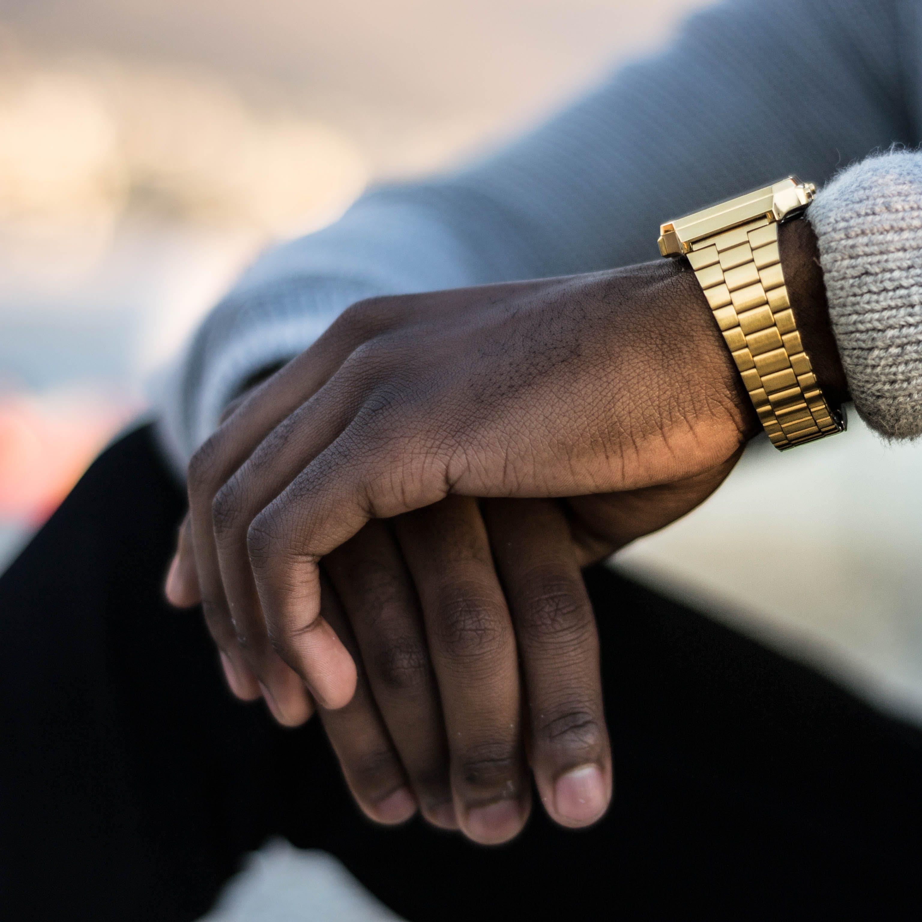 Man Wearing Gold-colored Wristwatch