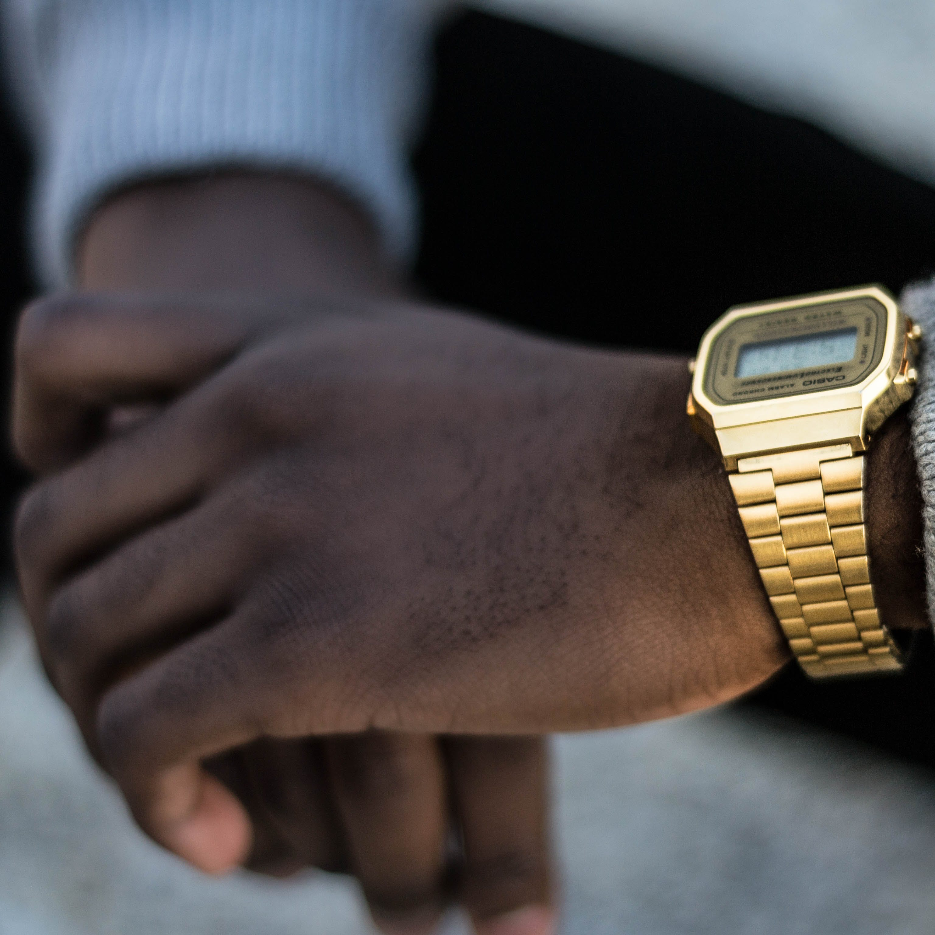 Person Wearing Gold-colored Casio Digital Watch With Linked Strap