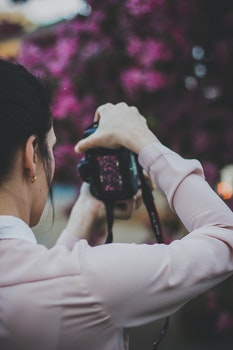 Free stock photo of person, woman, camera, taking photo