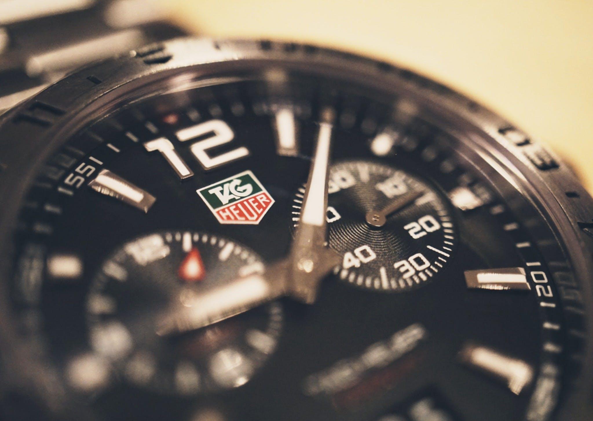 Round Black Tag Heuer Chronograph Watch