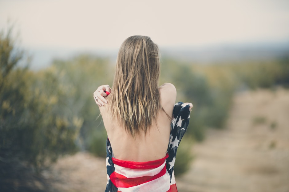 Woman Strapping Her Body of American Flag
