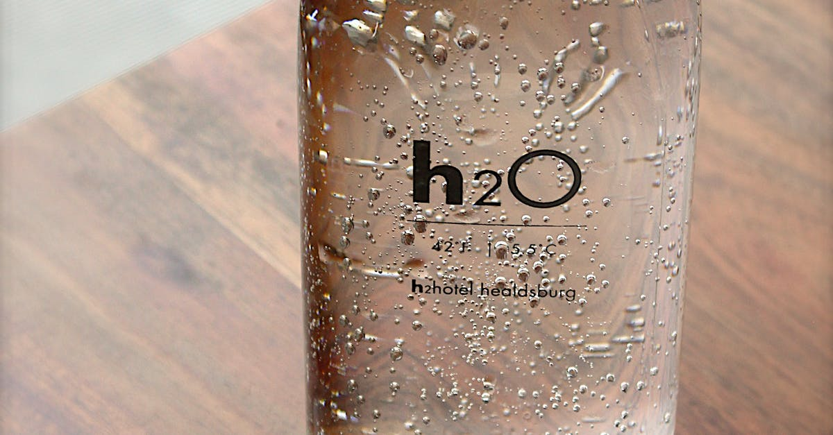 clear glass h2o bottle free stock photo