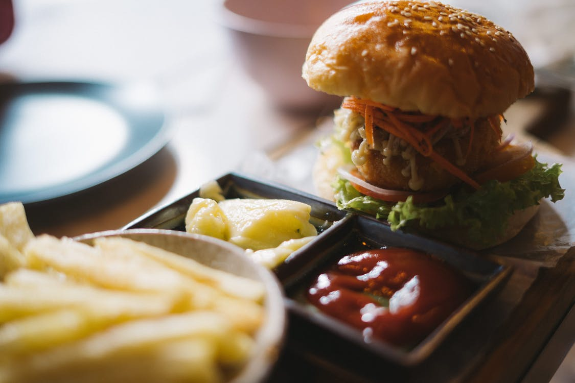 Serving of Burger With Potato Fries