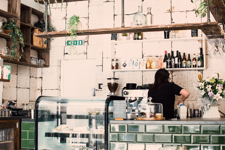 Woman Wearing Black Shirt in a coffee shop