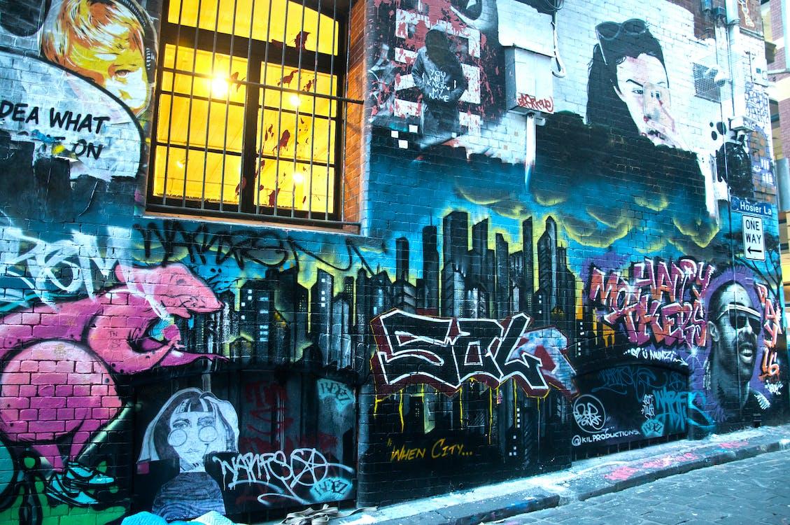 Photography of Graffiti on Brickwall