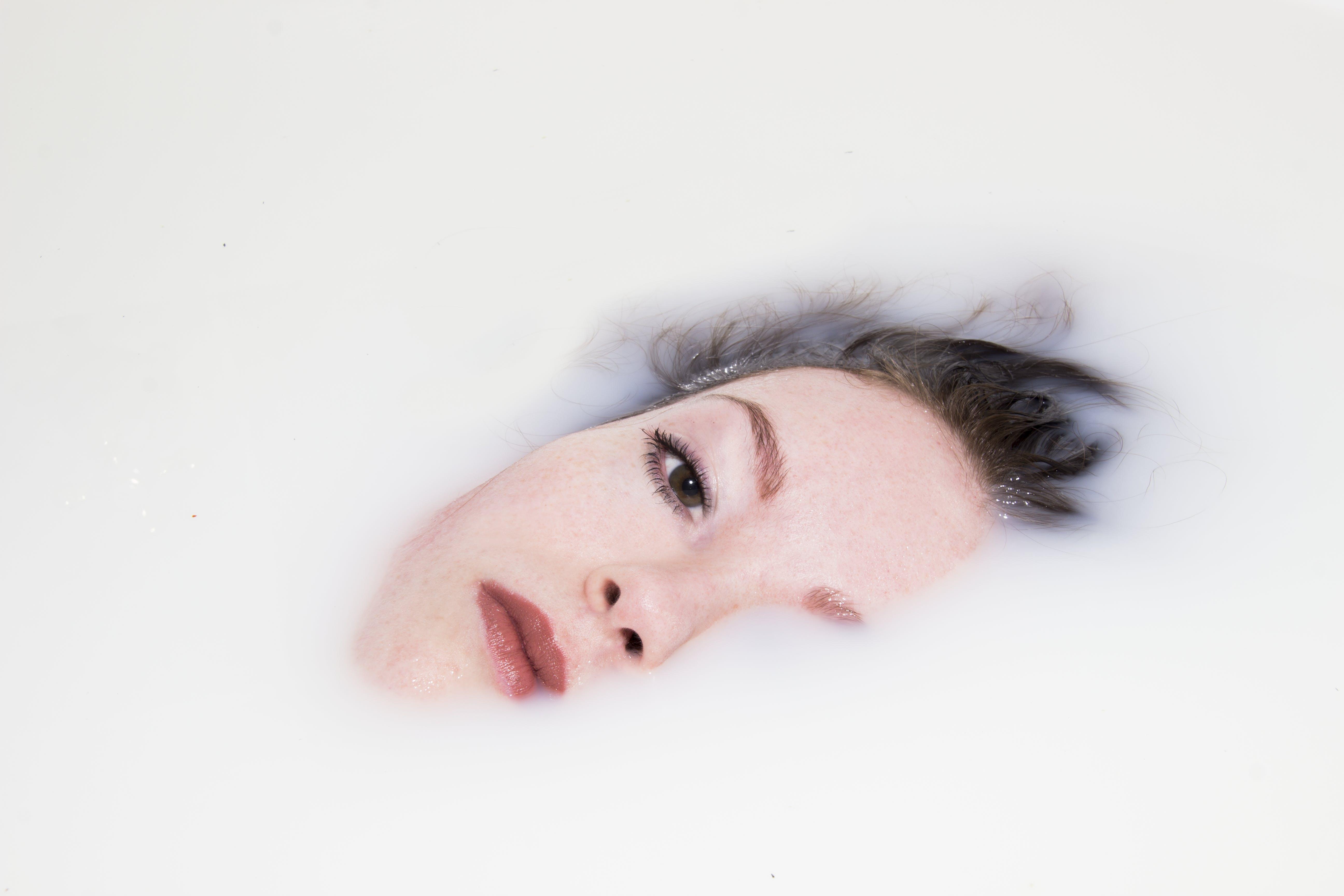 Woman's Face on White Liquid
