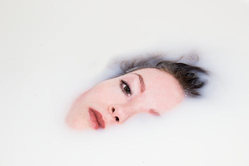 Woman's Face on White Liquid