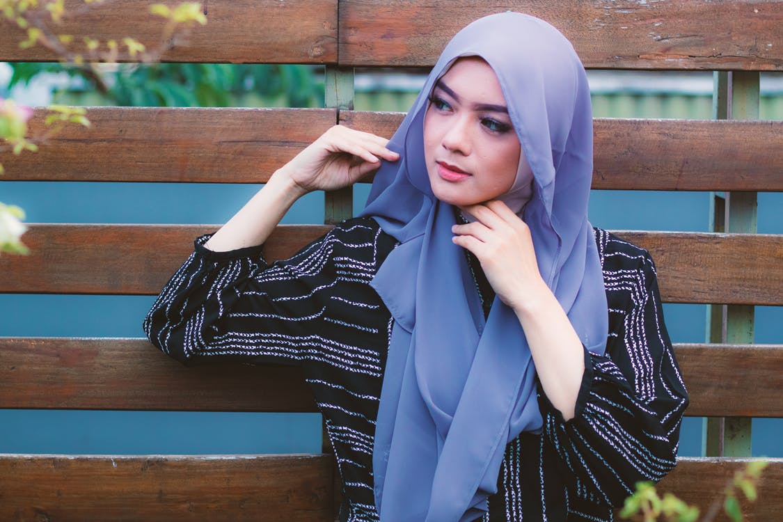 Photography of a Woman Wearing Blue Hijab