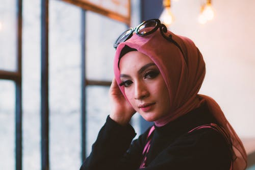 Woman in Pink Headdress With Sunglasses on Her Head