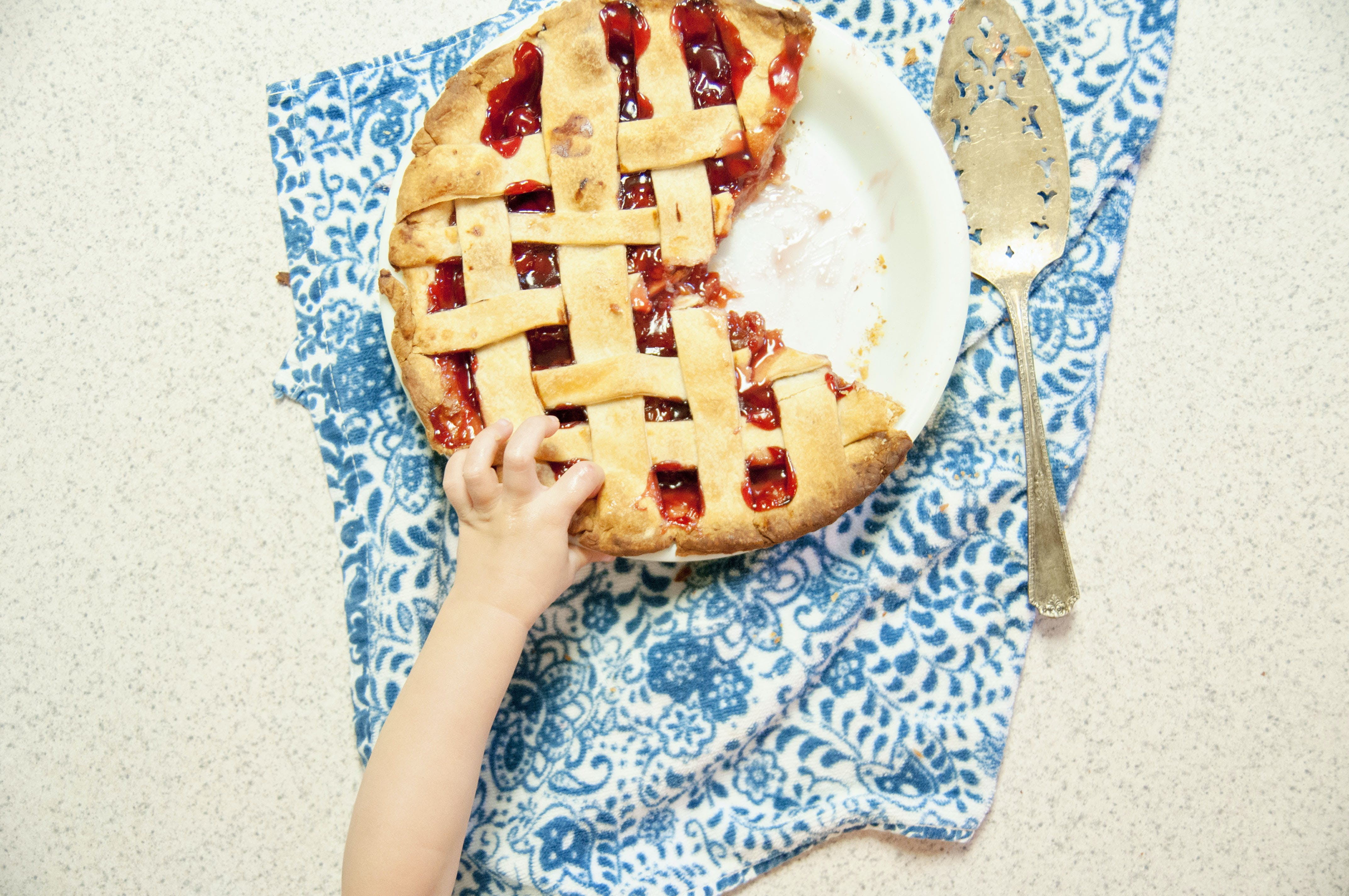 Free stock photo of blue, blue towel, cherry pie, child