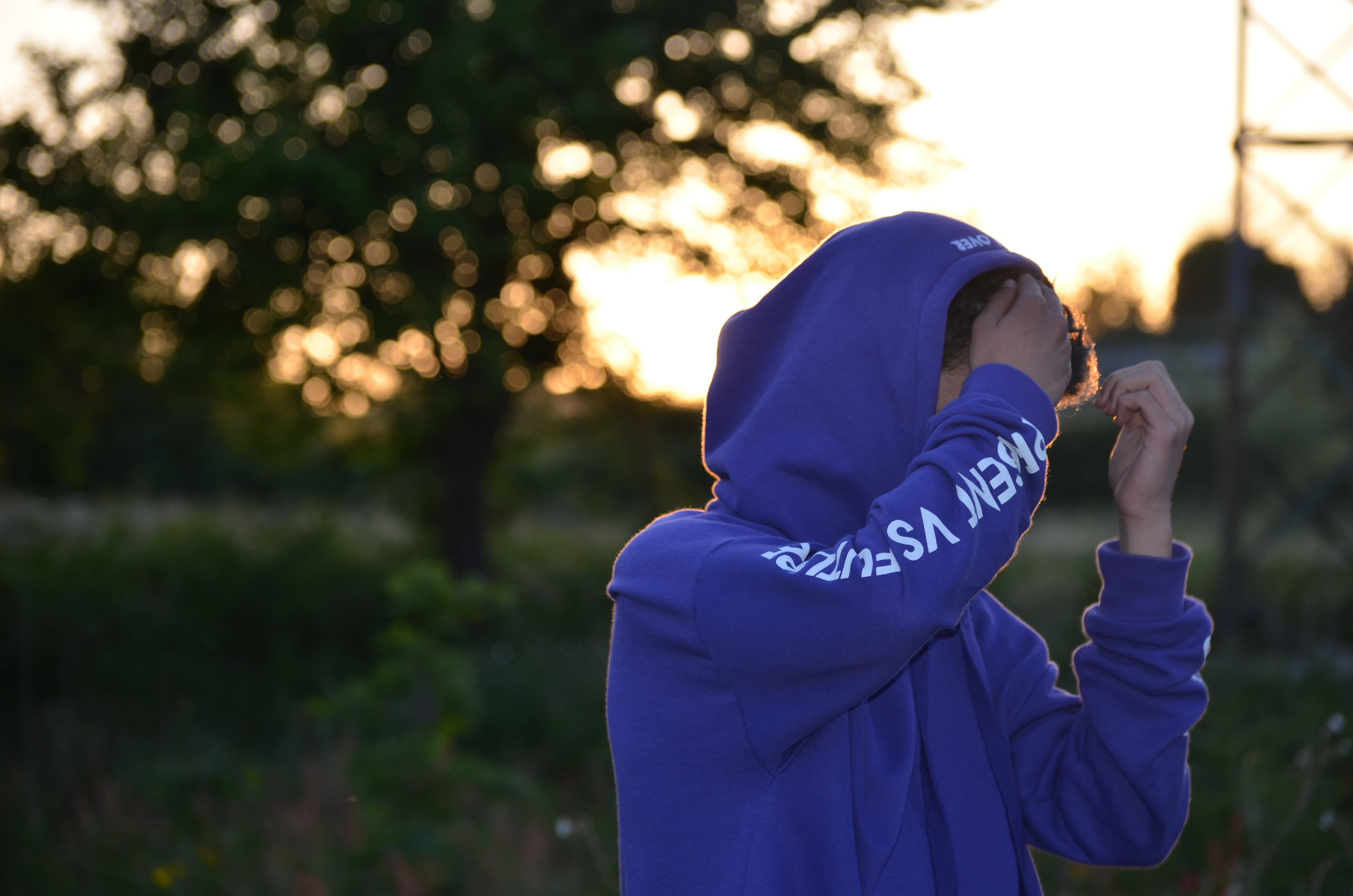 Shallow Focus Photo of Man in Blue Hoodie