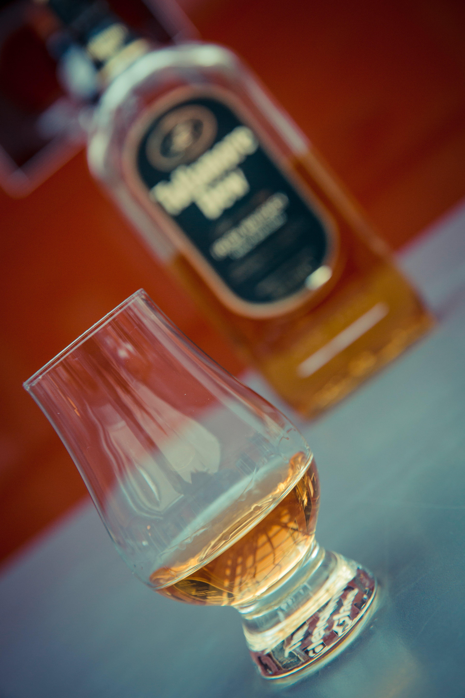 Clear Brandy Glass Near Wine Bottle