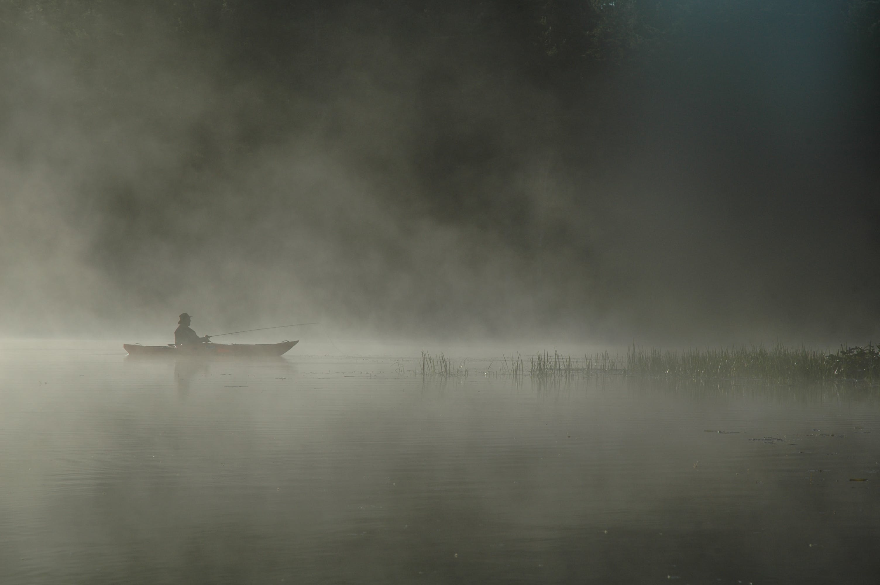 Person Riding Boat on Body of Water