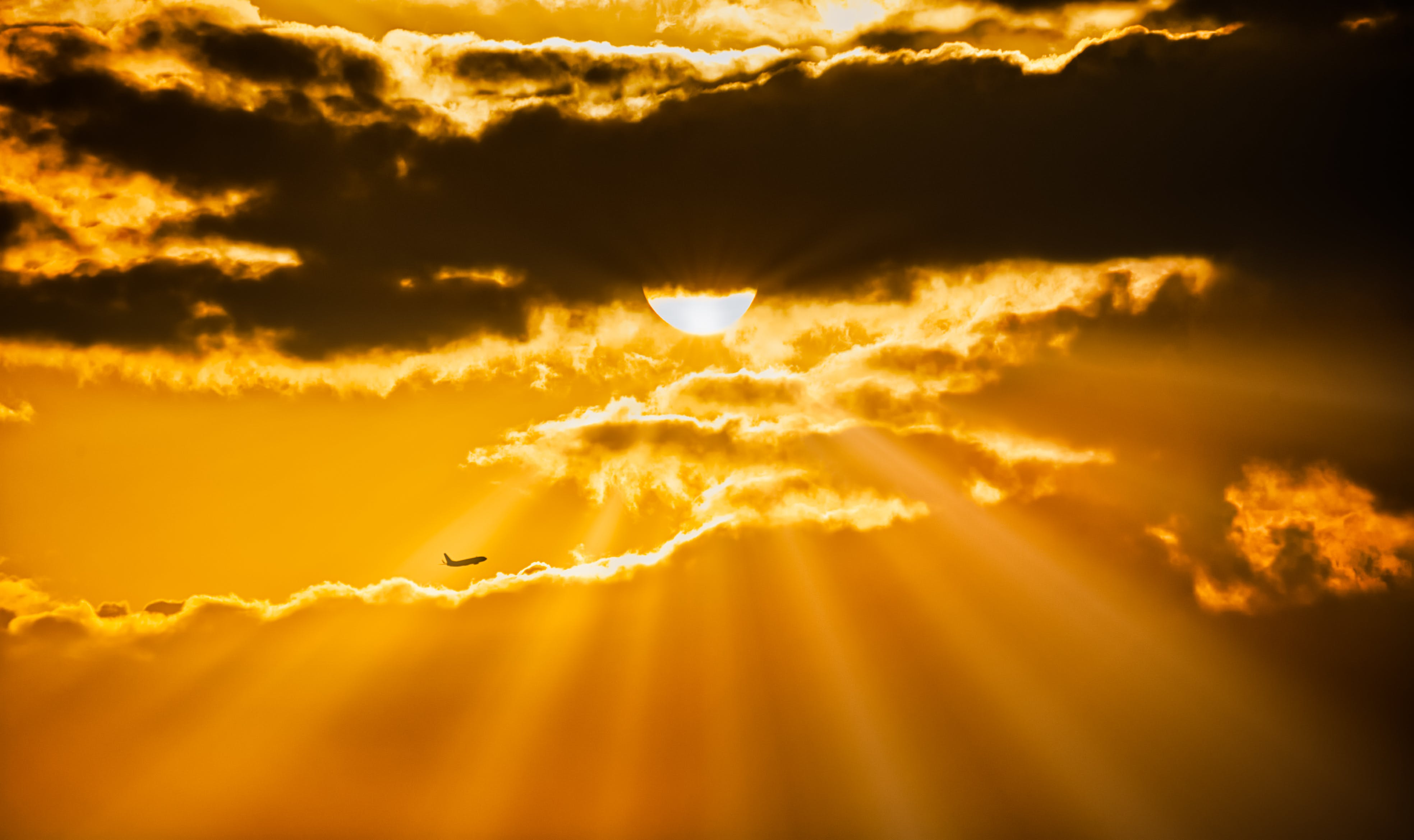 Airplane Flying During Golden Hour
