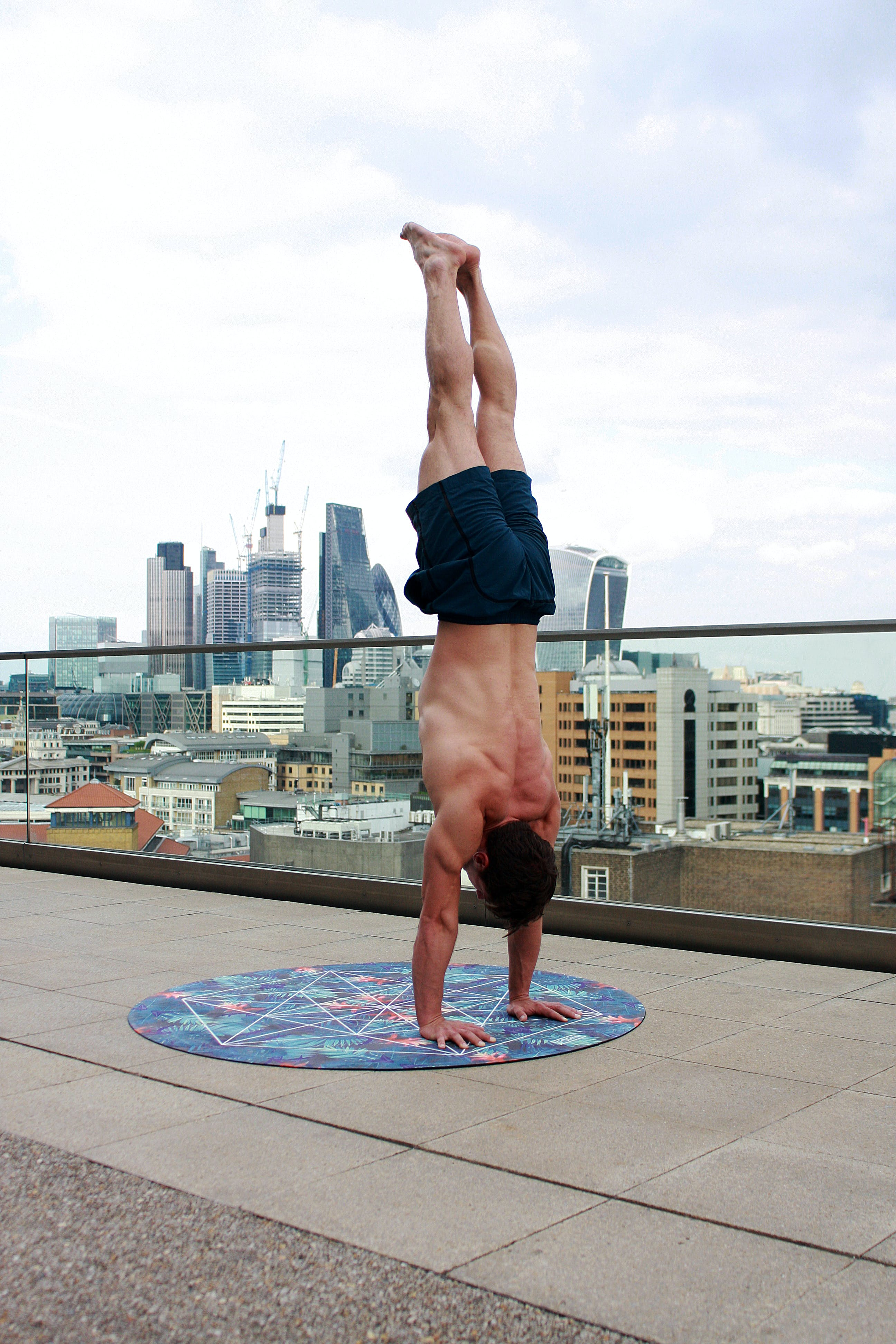 Man Wearing Black Shorts Doing Hand Stand