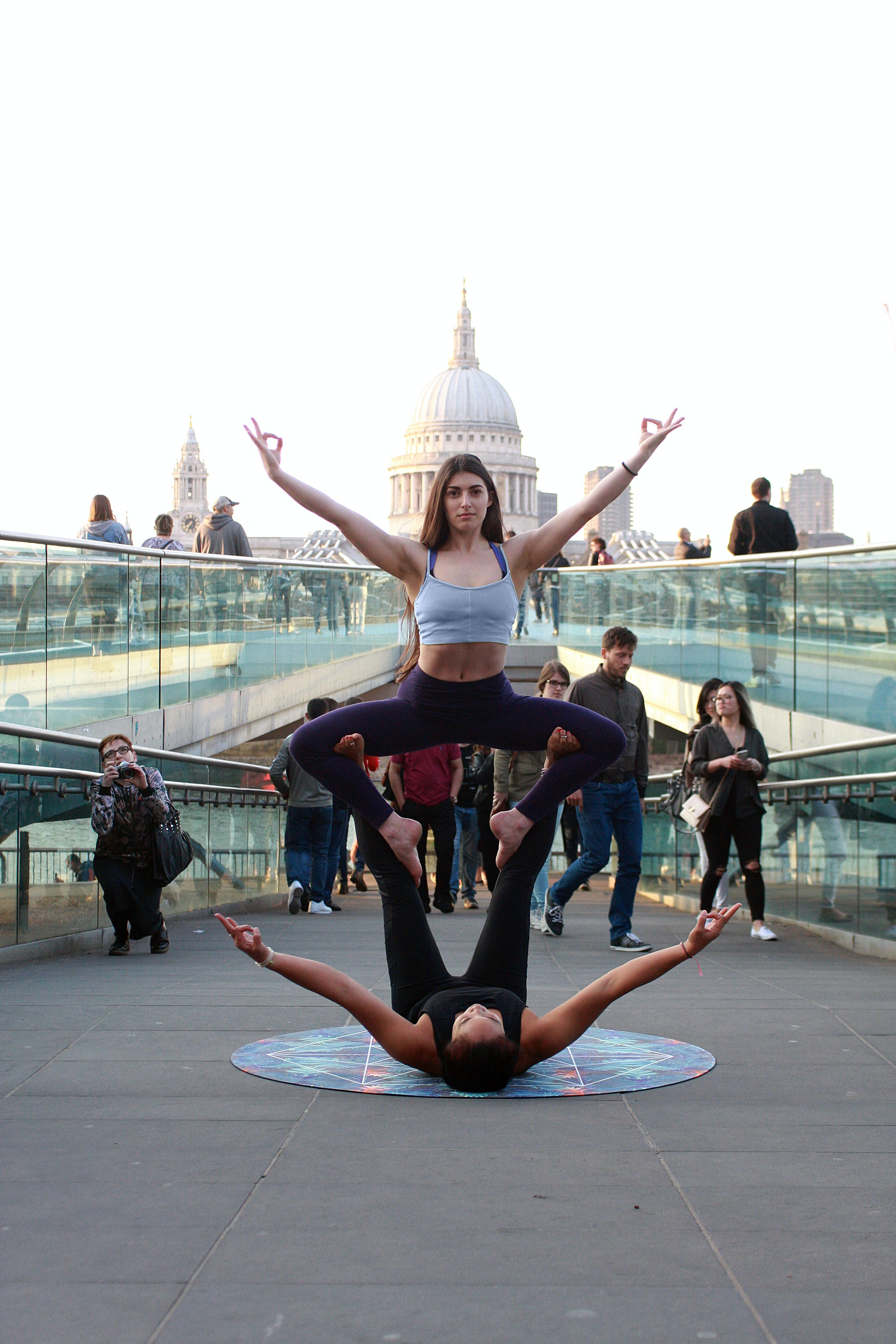 Two Women Performing Yoga on Street at Daytime