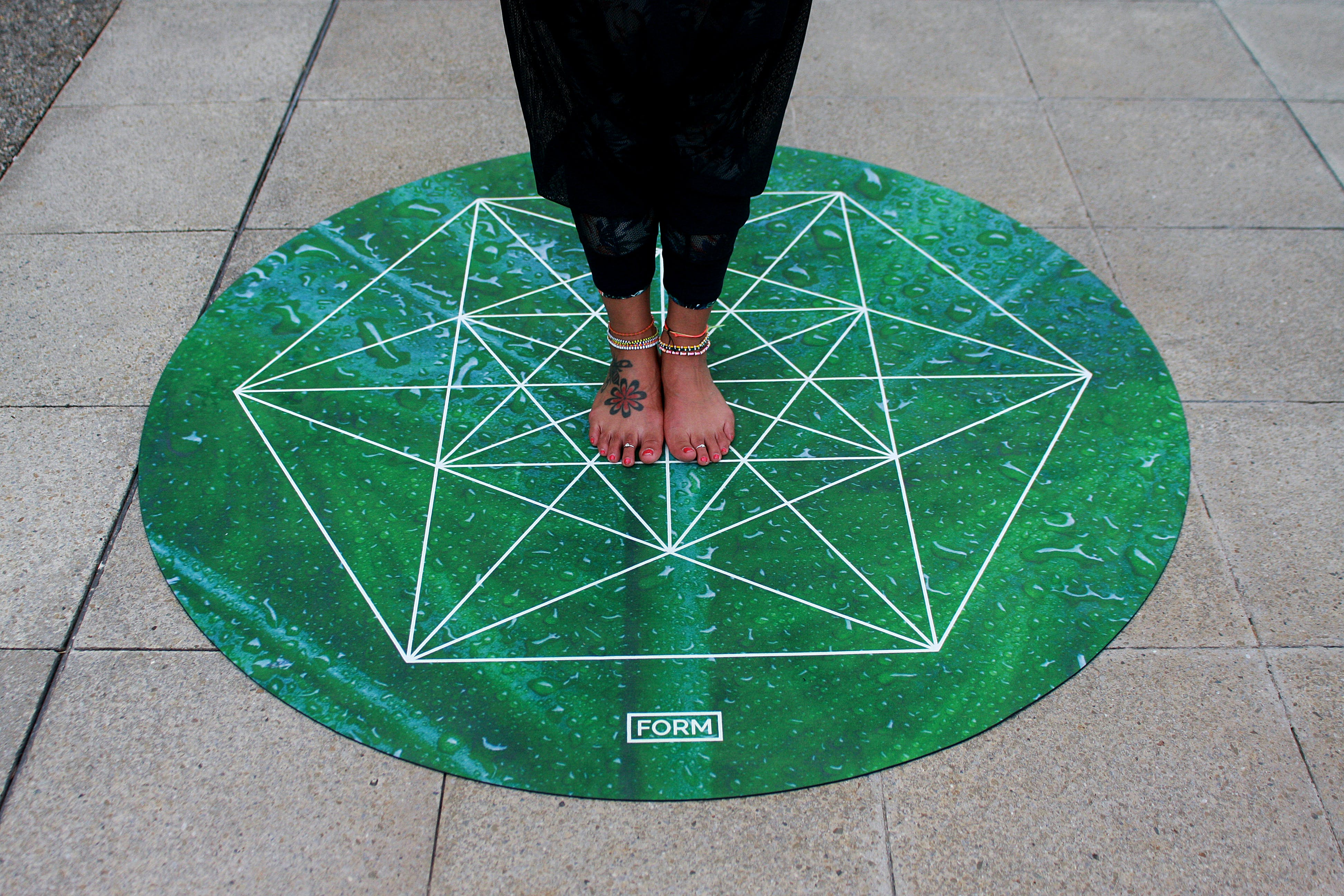 Person Standing on Green Round Mat