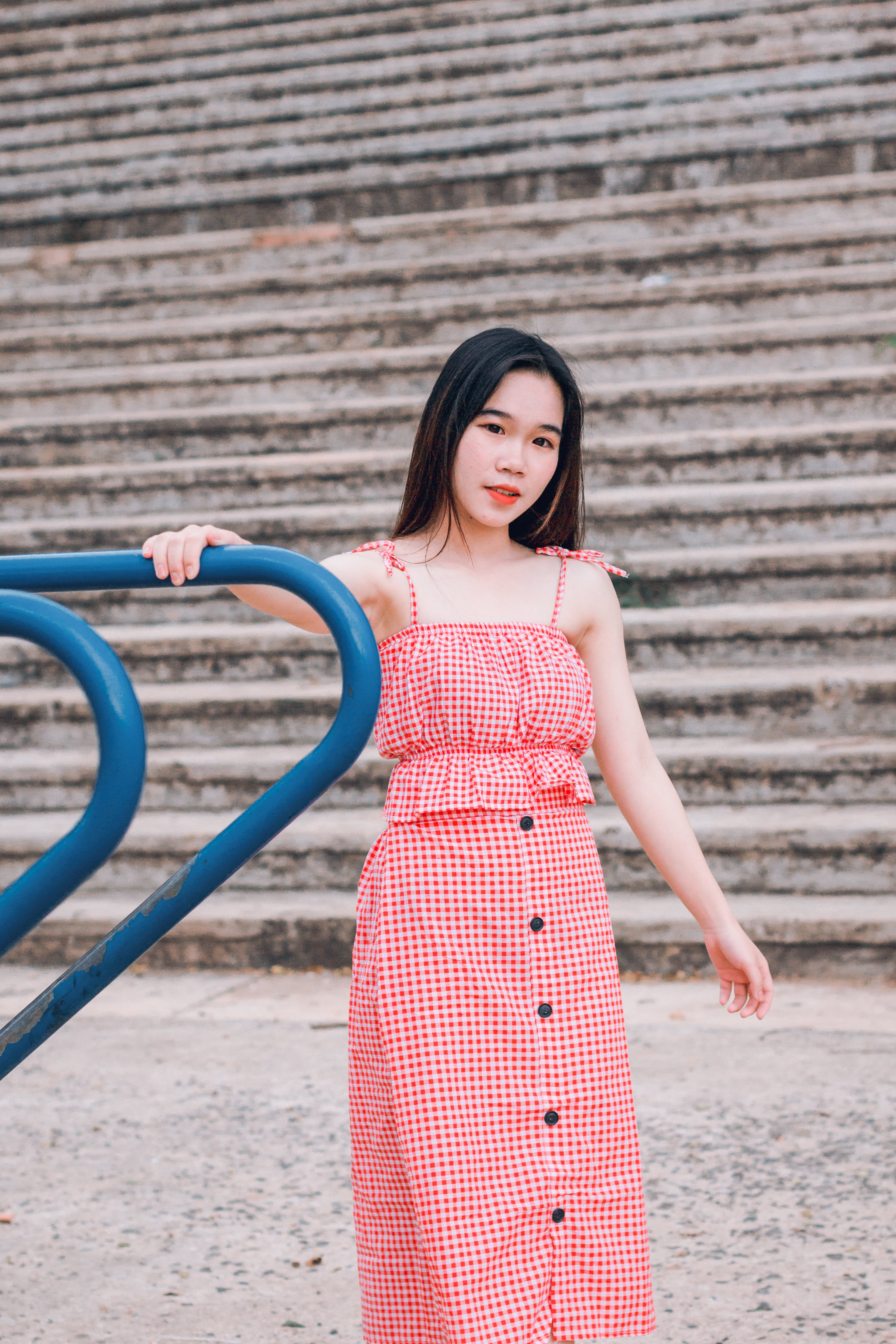 Woman in Red and White Spaghetti Strap Dress
