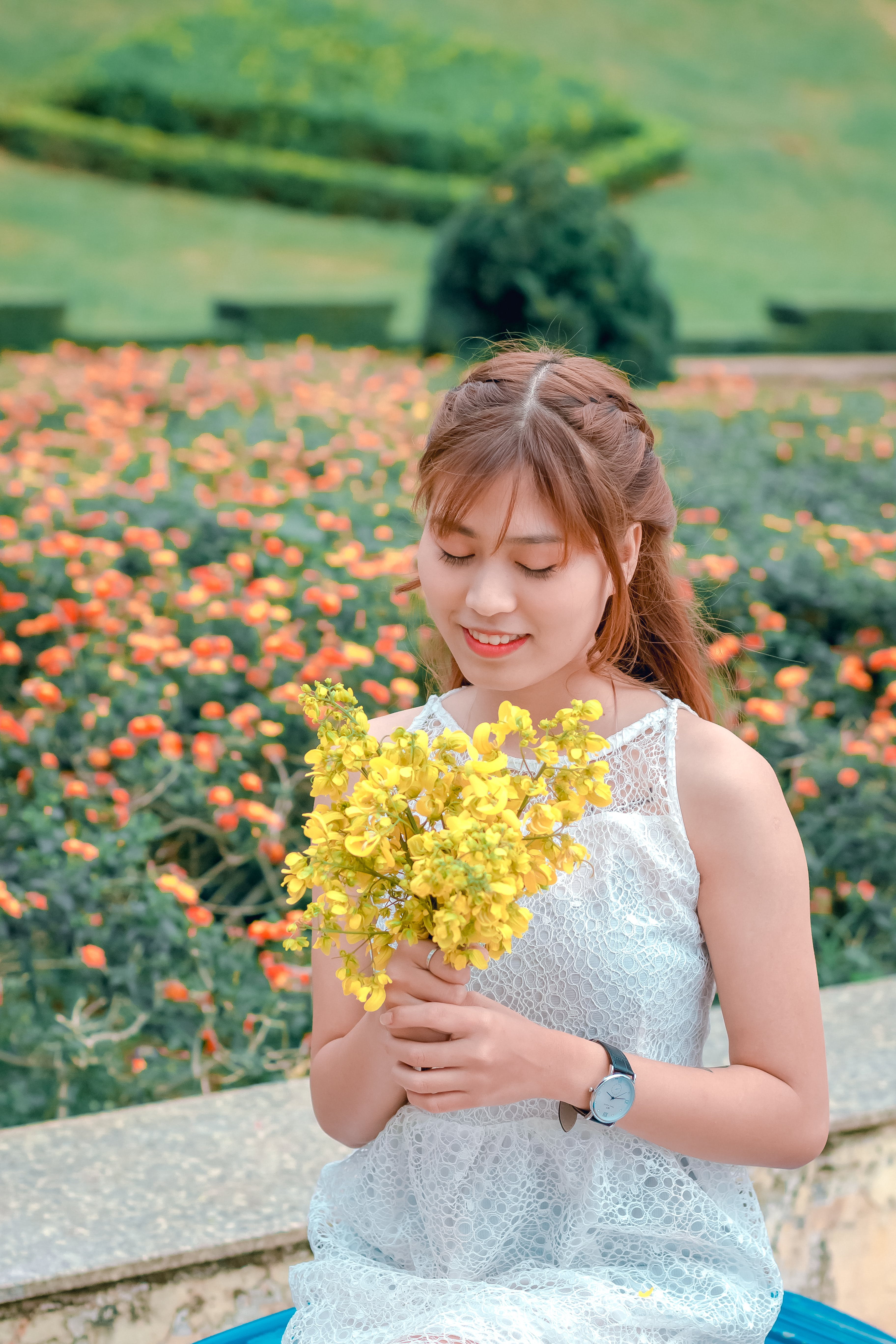 Woman Wearing White Top Holding Yellow Petaled Flowers