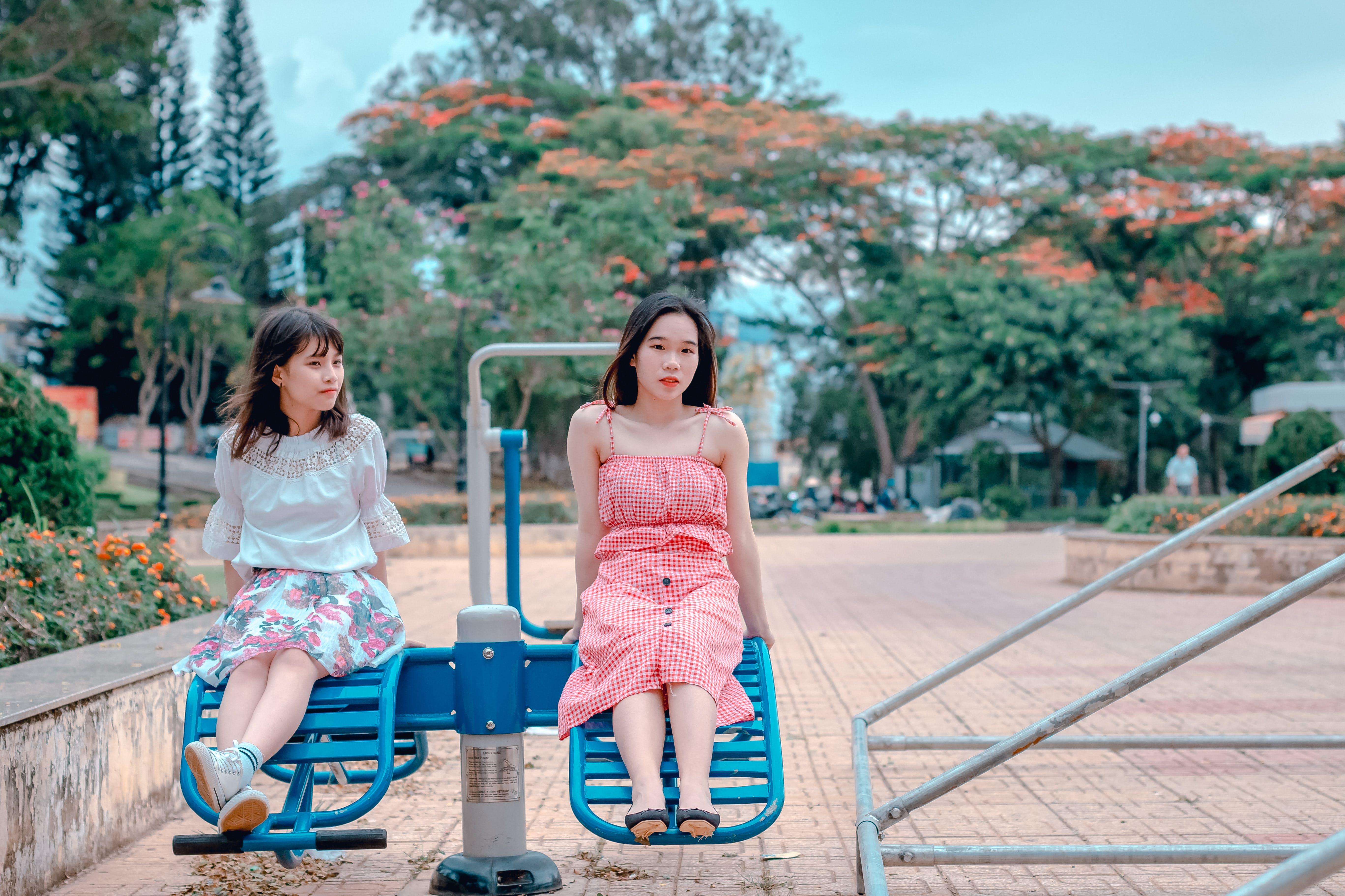 Two Woman Sitting at Park Ride