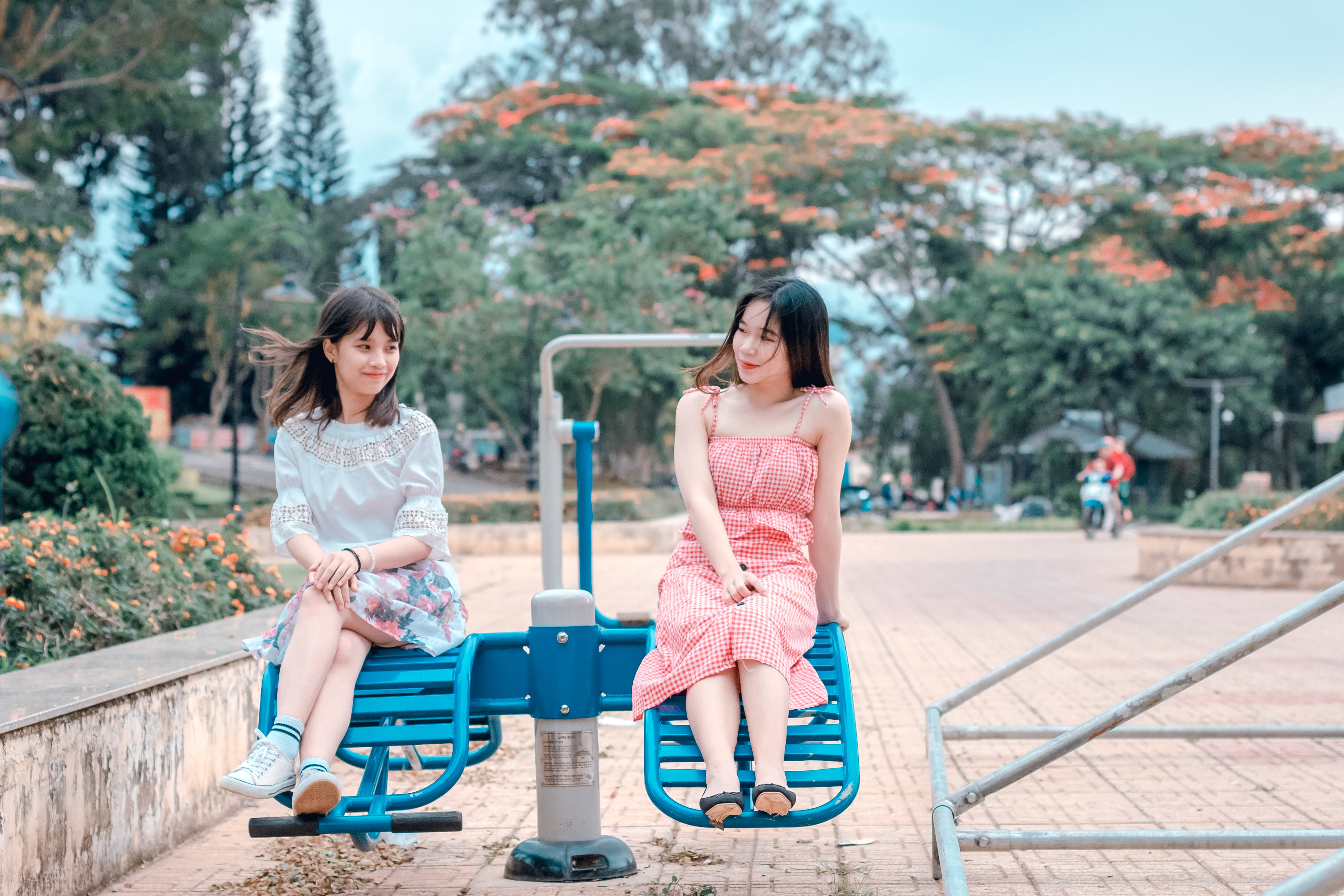 Two Women Sitting in Blue Park Ride