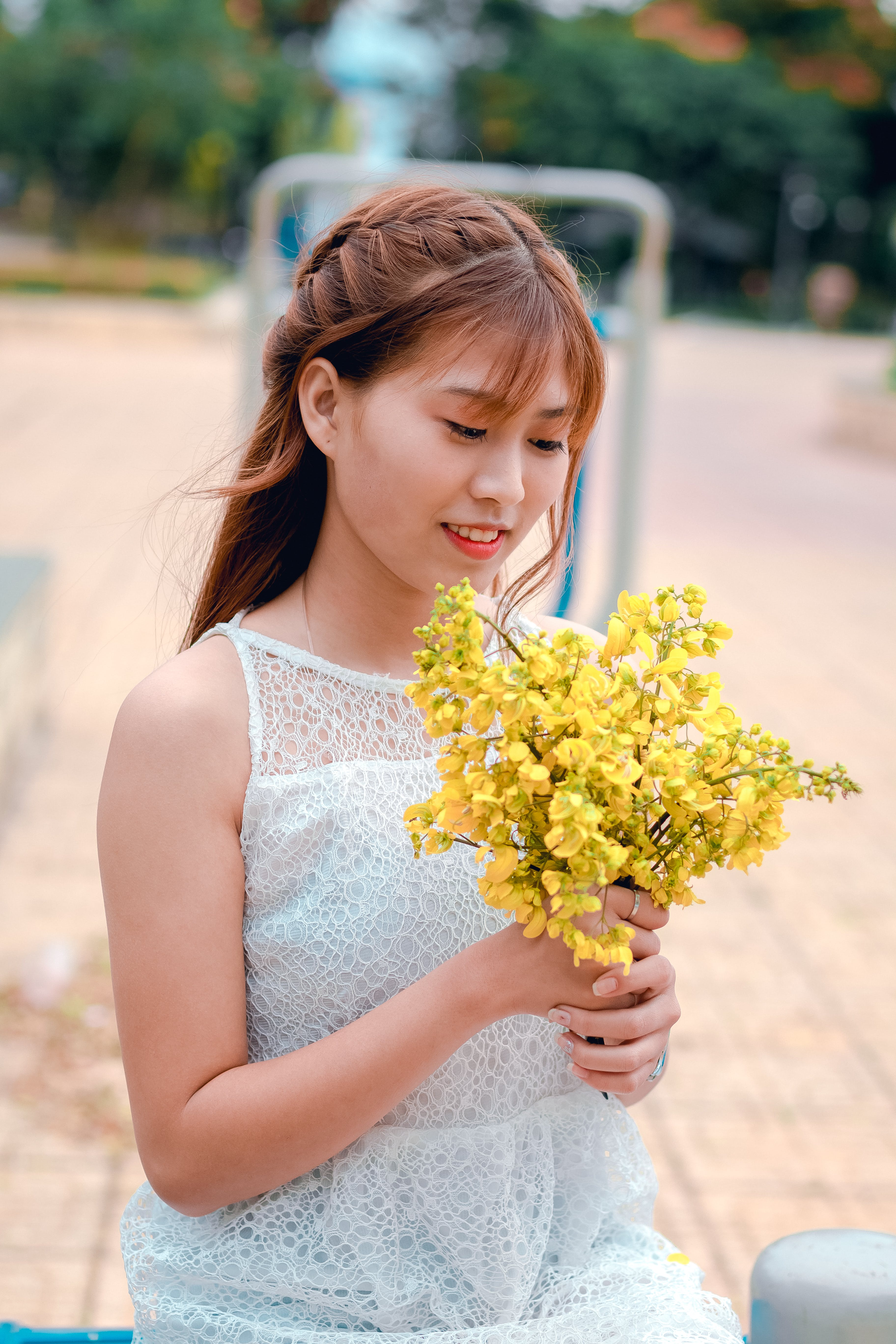 Woman Holding Yellow Petaled Flower Bouquet