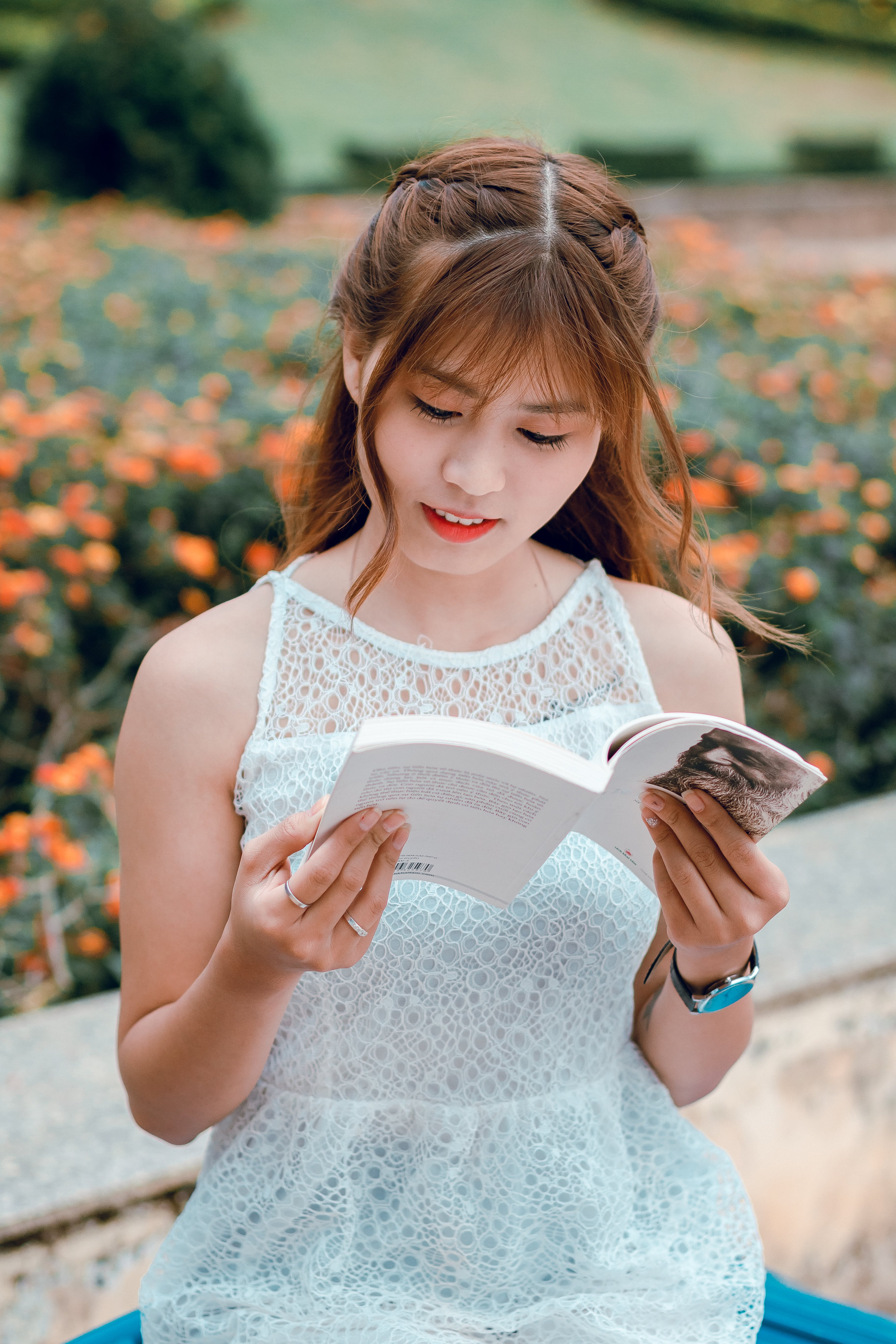 Selective Focus Photography Of Woman Reading A Book