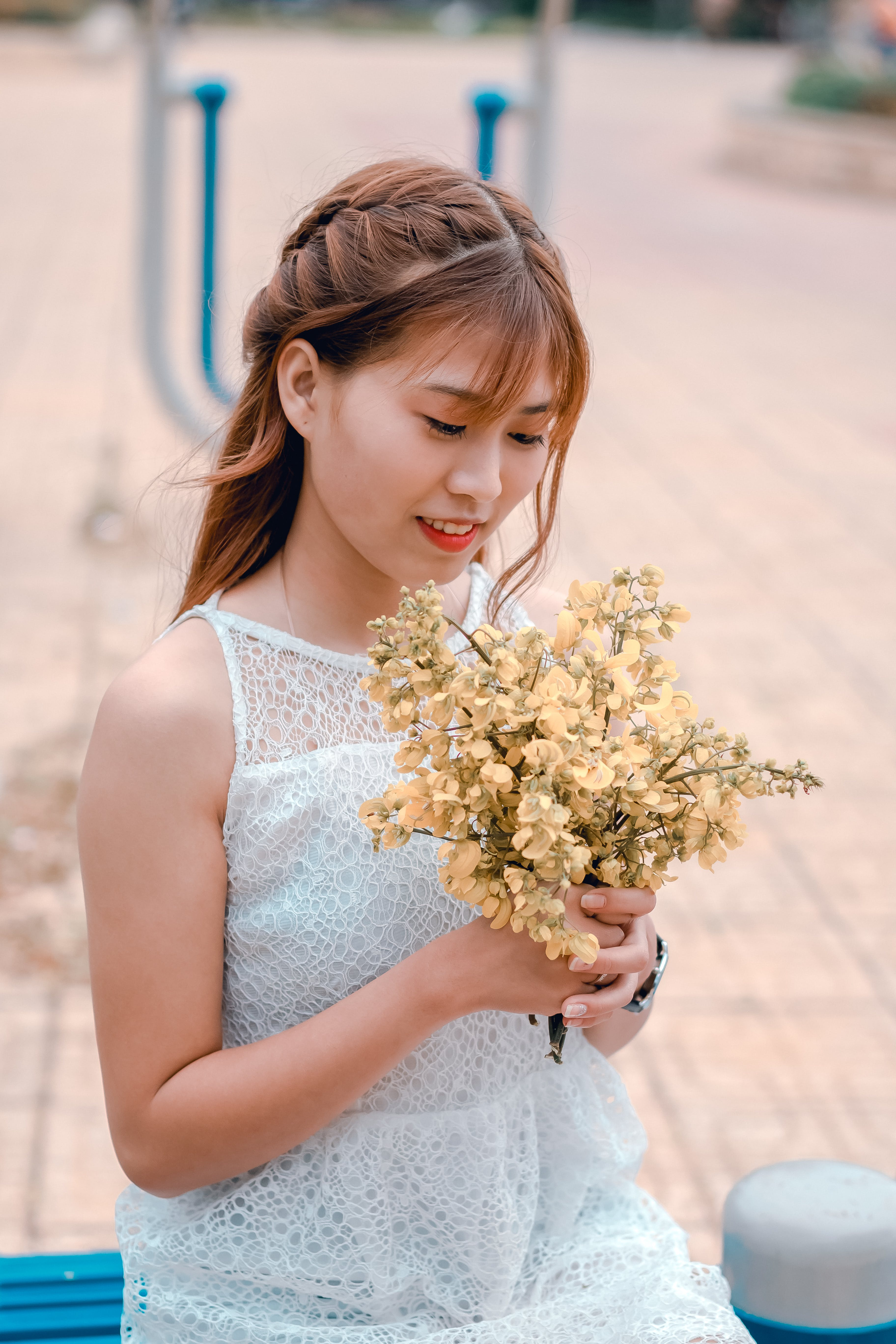 Woman Wearing White Lace Dress Holding Yellow Flower Bouquet