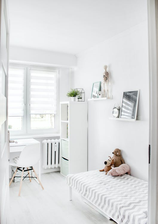 Plush Toys on Top of White and Grey Mattress Inside Bedroom