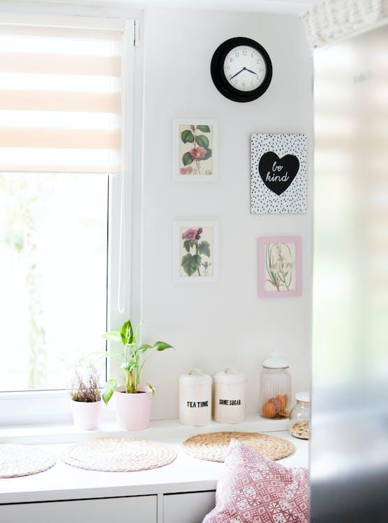 Pots Near Windowpane on White Wooden Cabinet