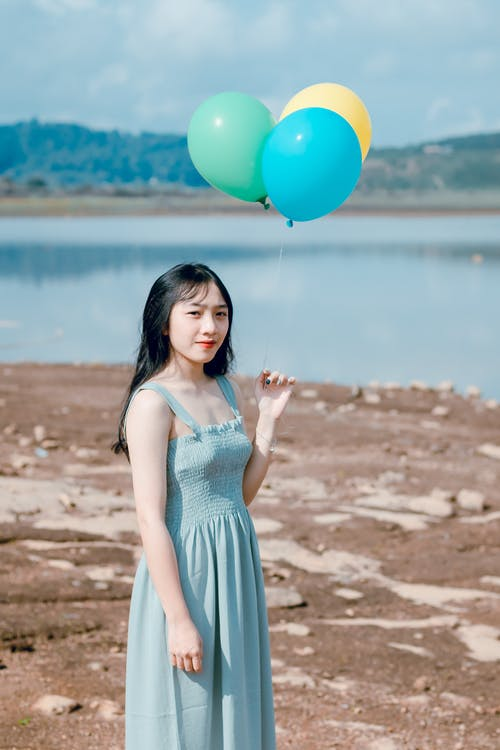 Photography of a Woman Holding Balloons