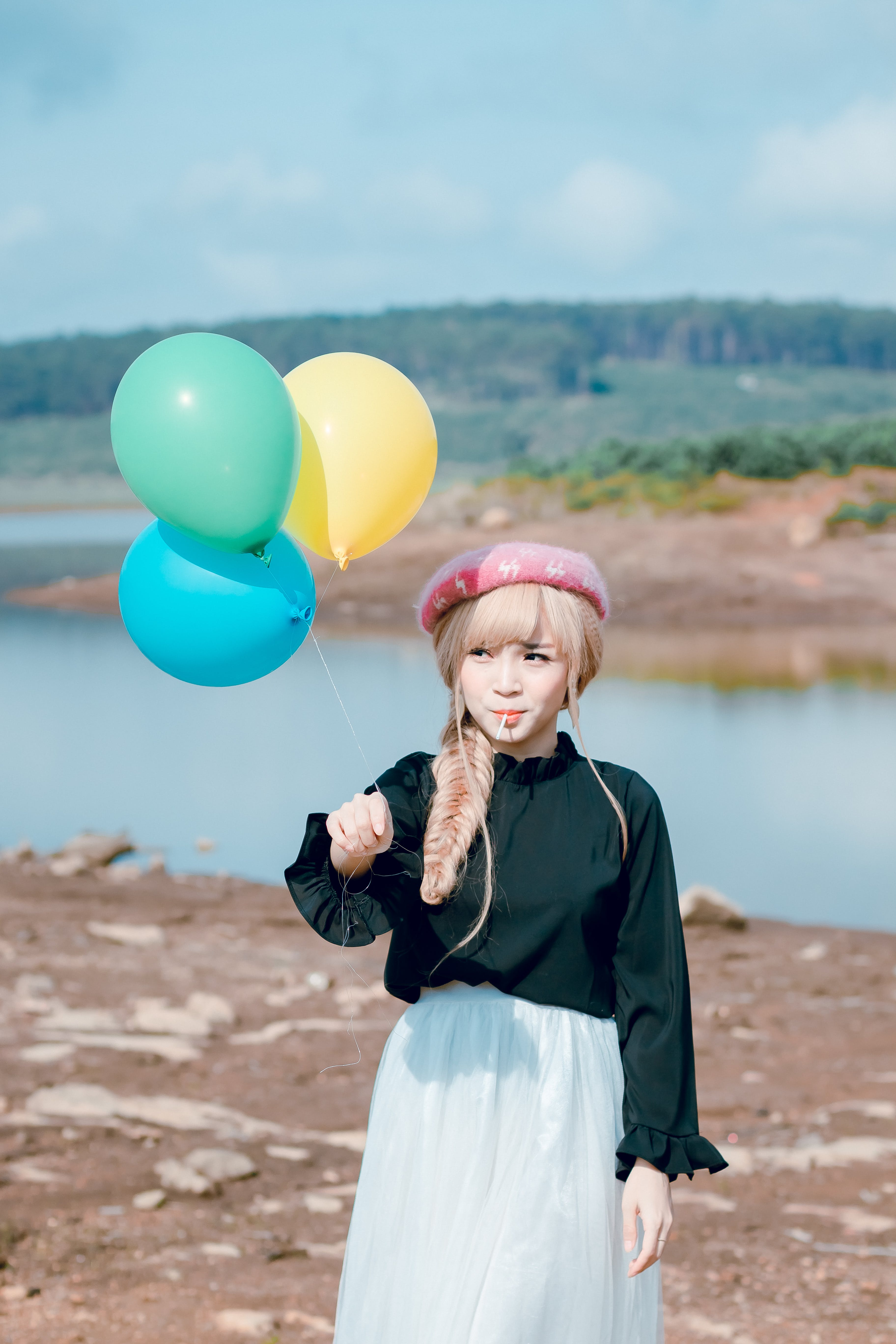 Girl In Black Top Holding Balloons