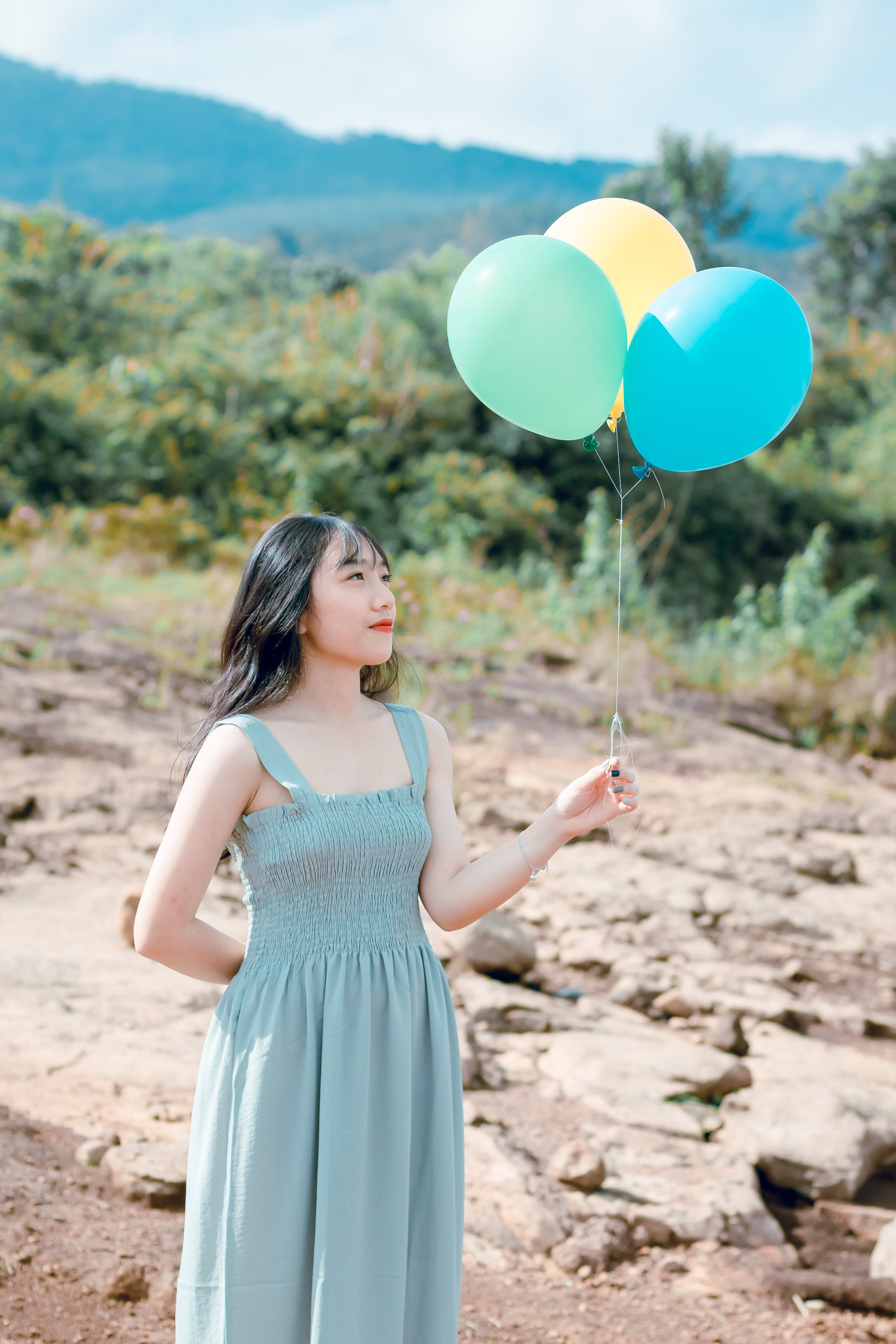 Woman In Dress Holding Balloons