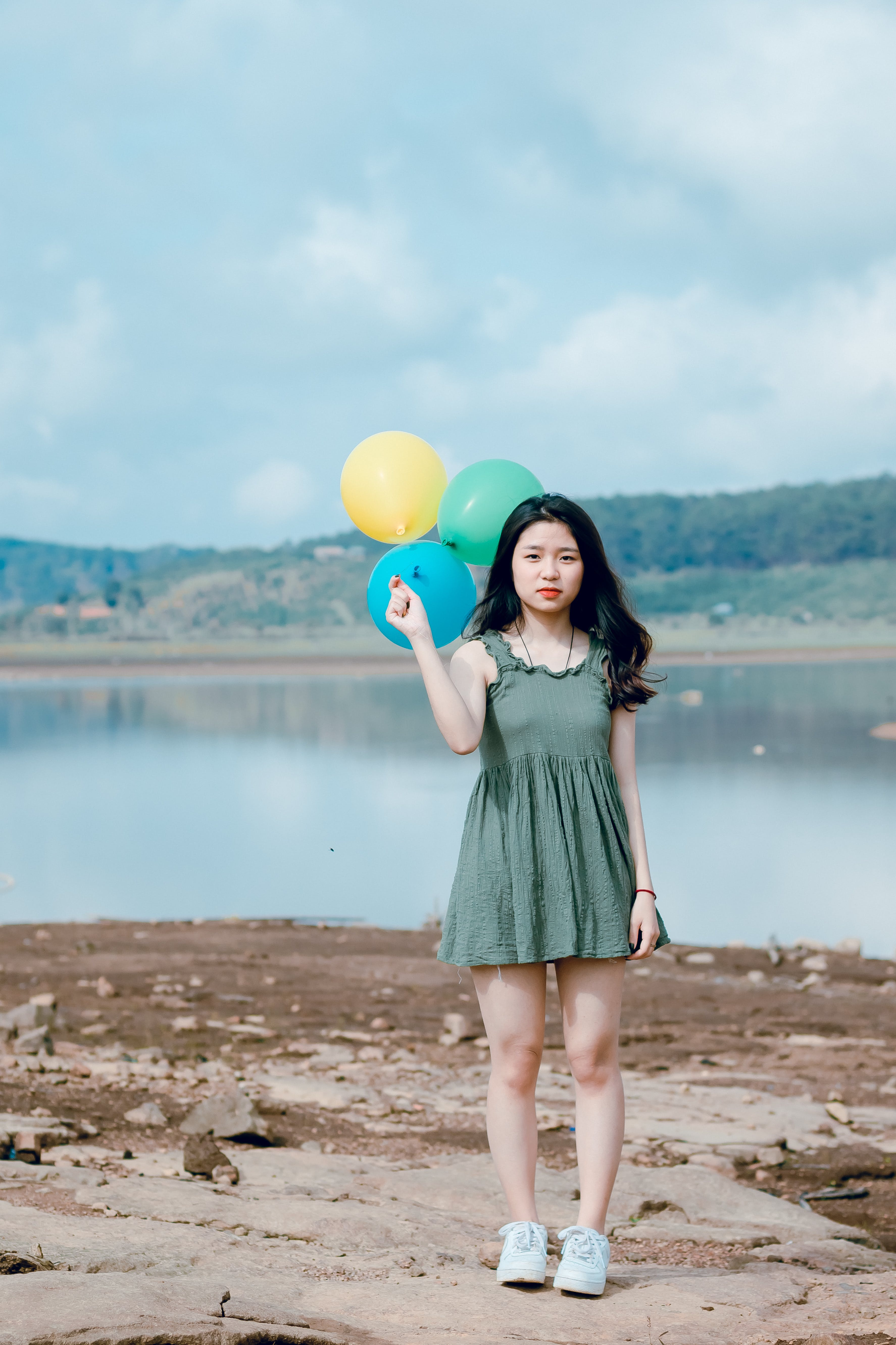 Woman Holding Three Balloons