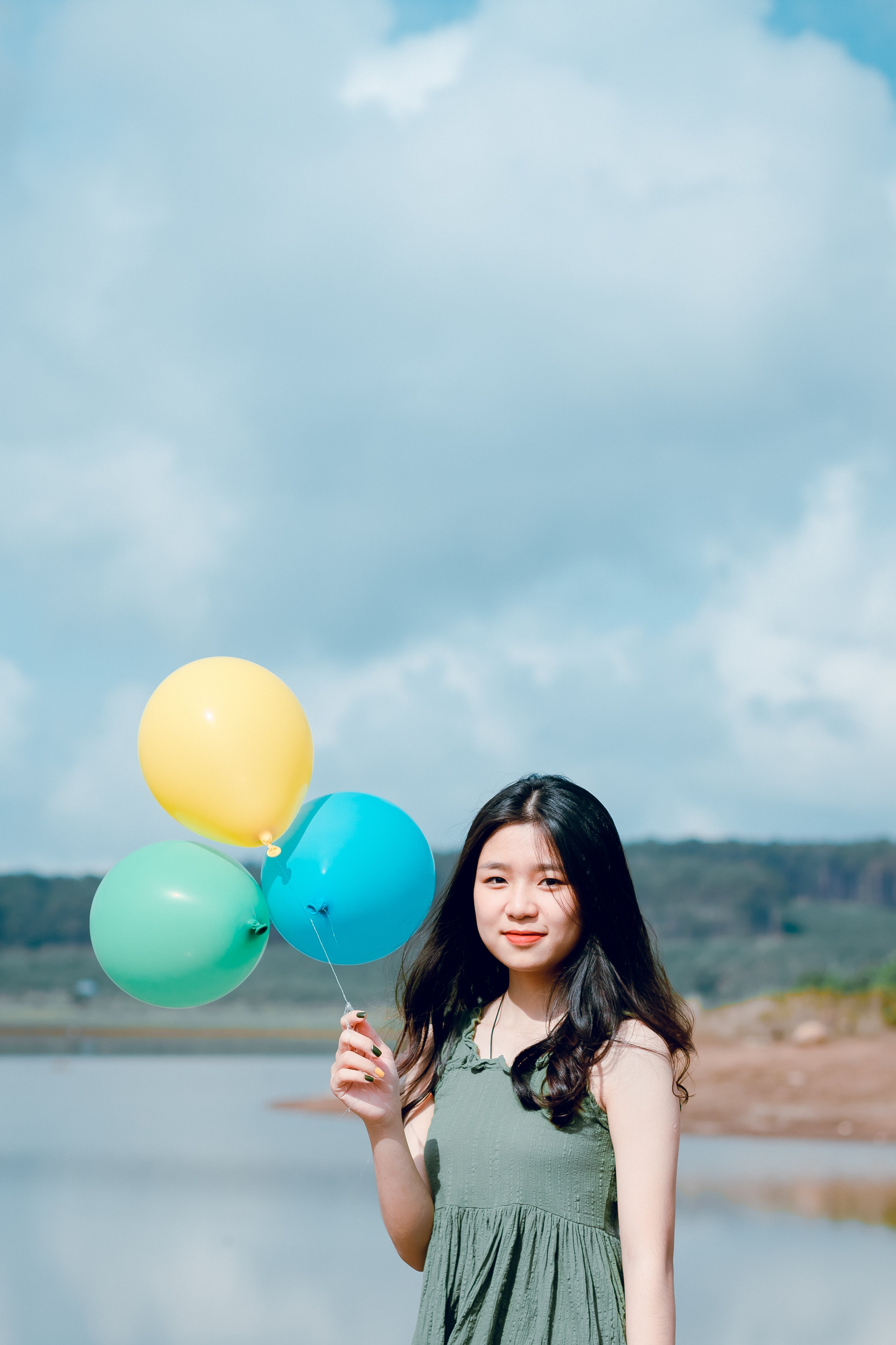 Woman In Green Sleeveless Top Holding Balloons