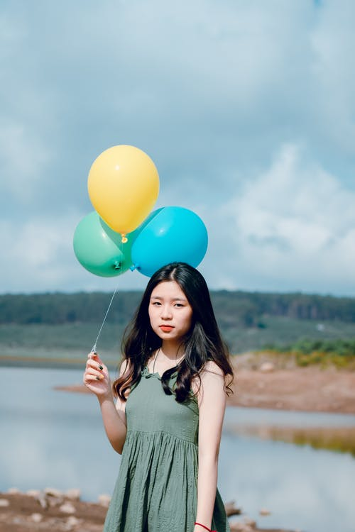 Woman Wearing Dress Holding Balloons