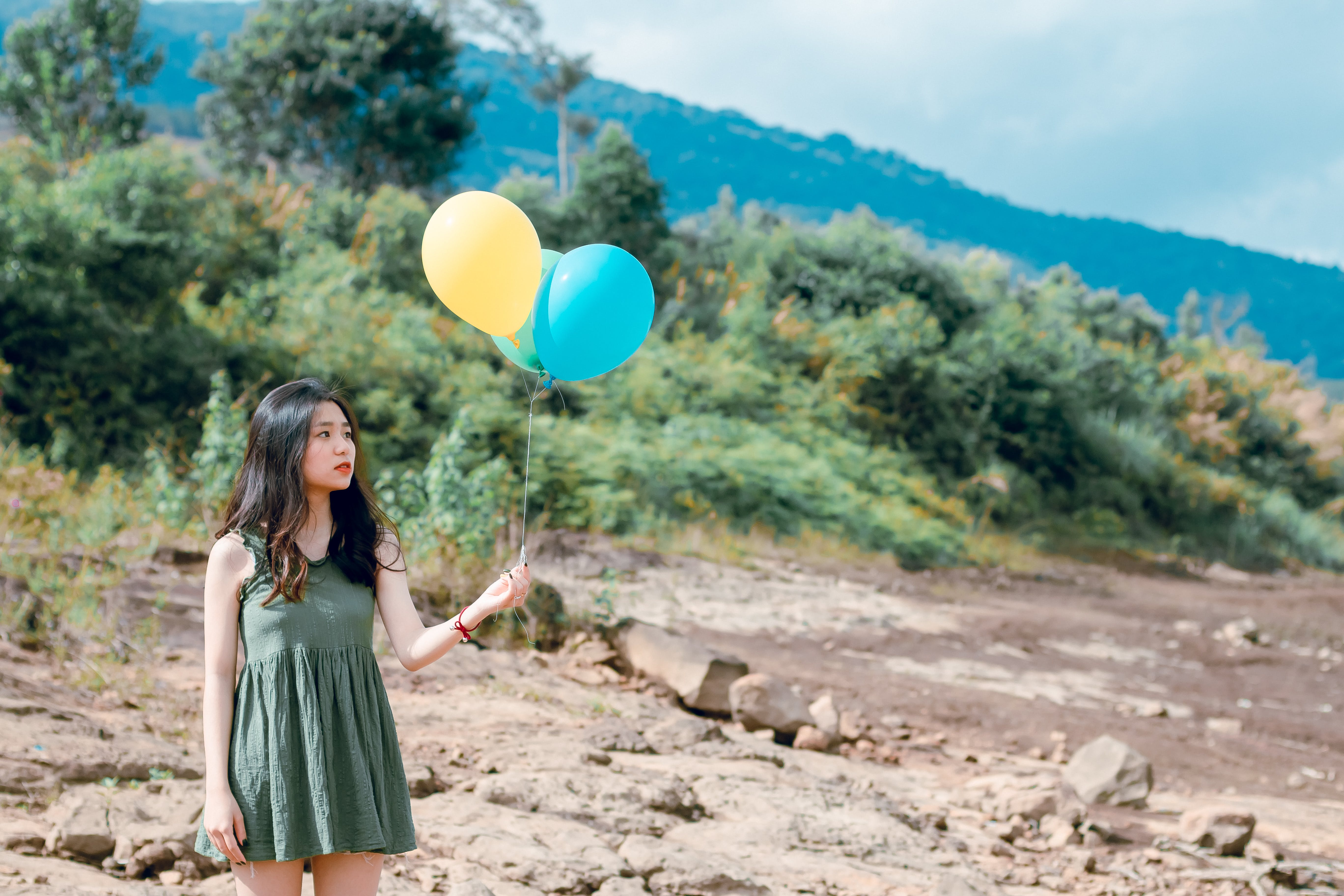 Portrait Photography of Woman Holding Balloons