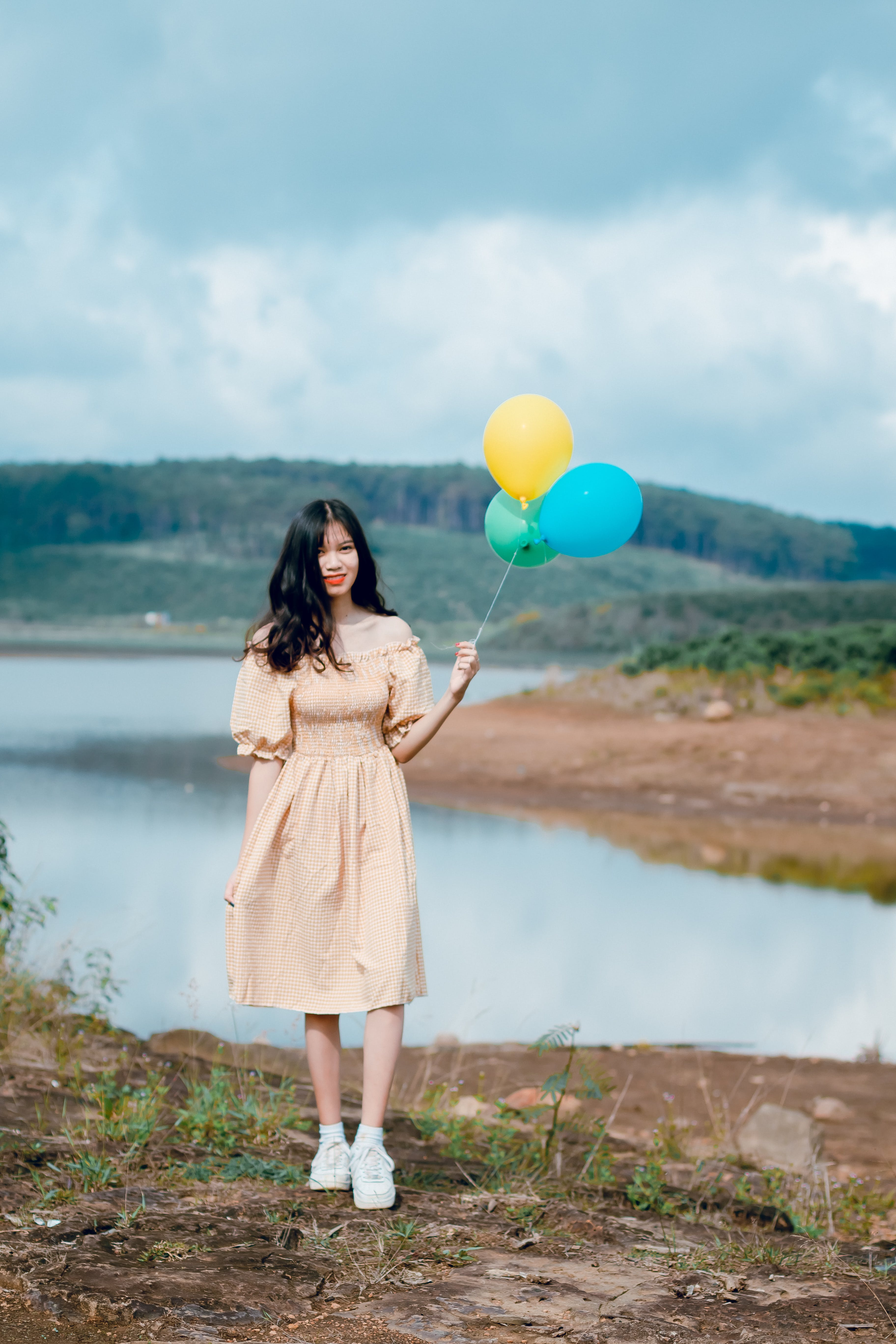 Shallow Focus Photography of Woman Holding Balloons