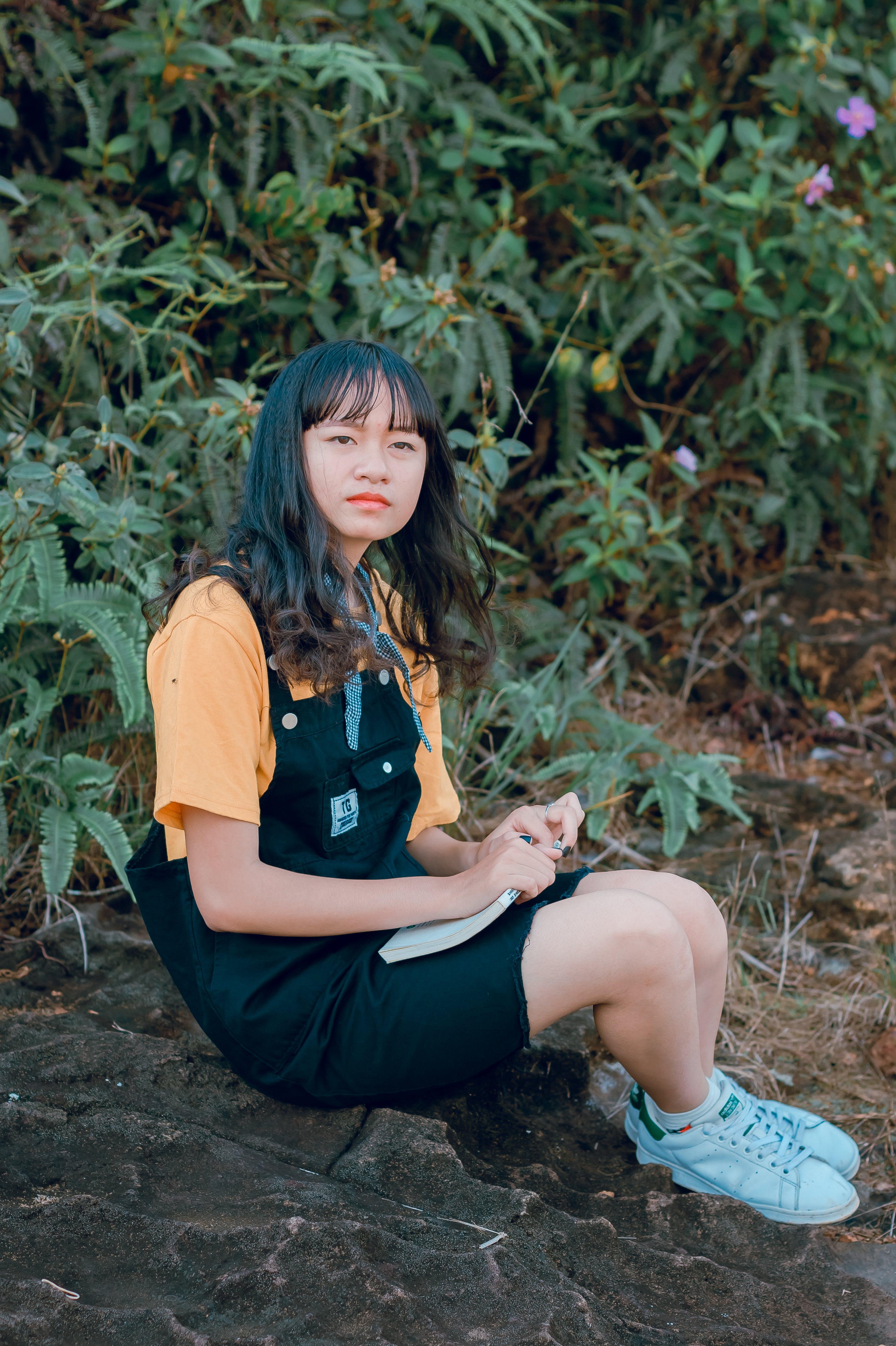 Girl in Black and Orange Shirt