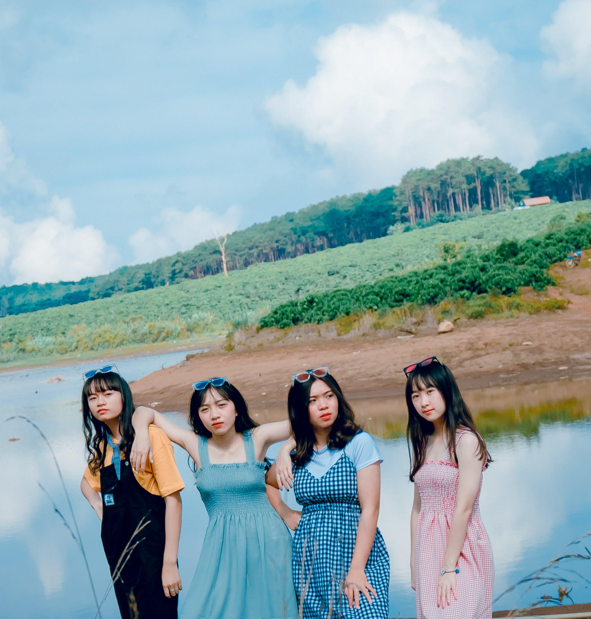 Four Women Near Body Of Water
