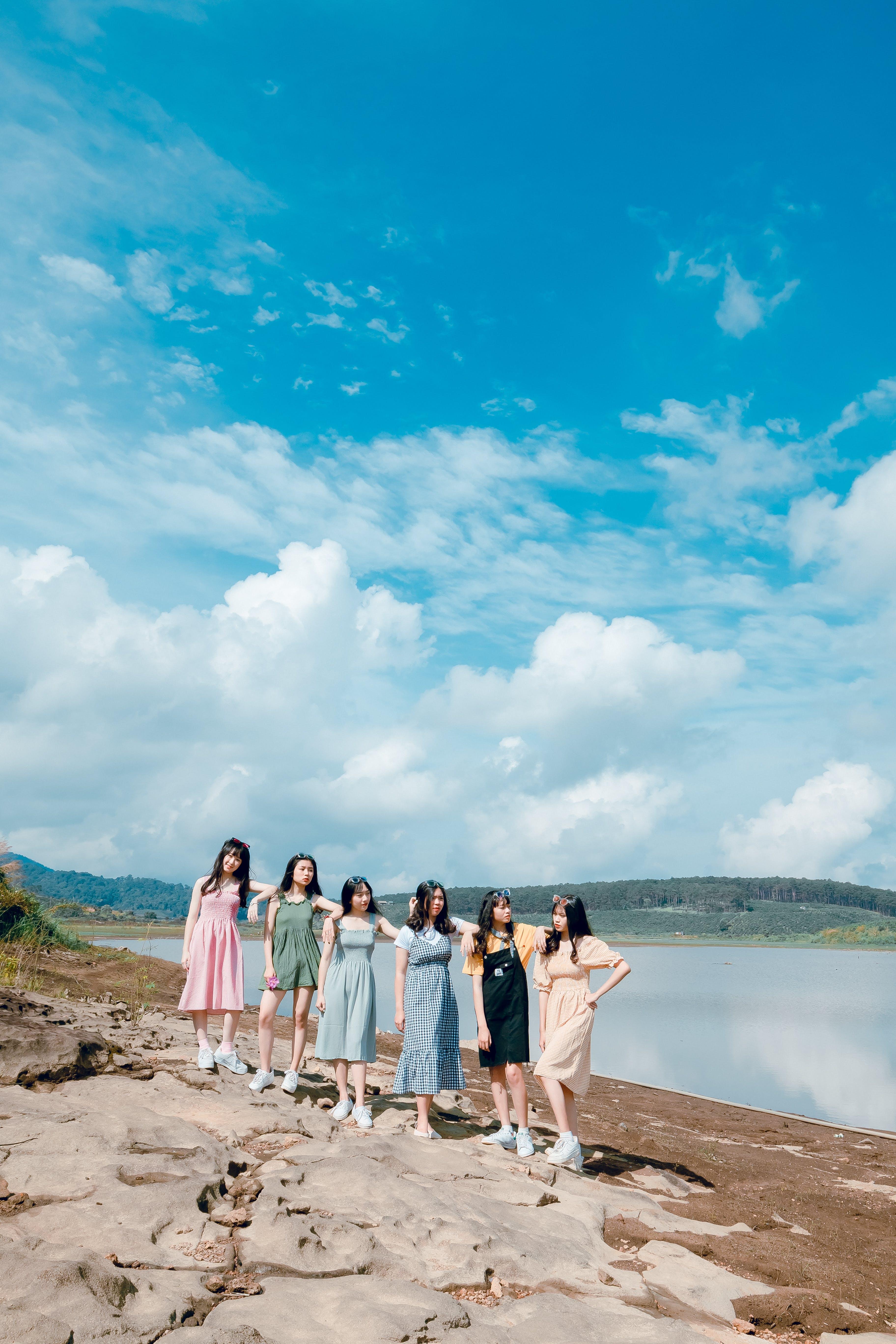Photo of Six Women on Brown Soil