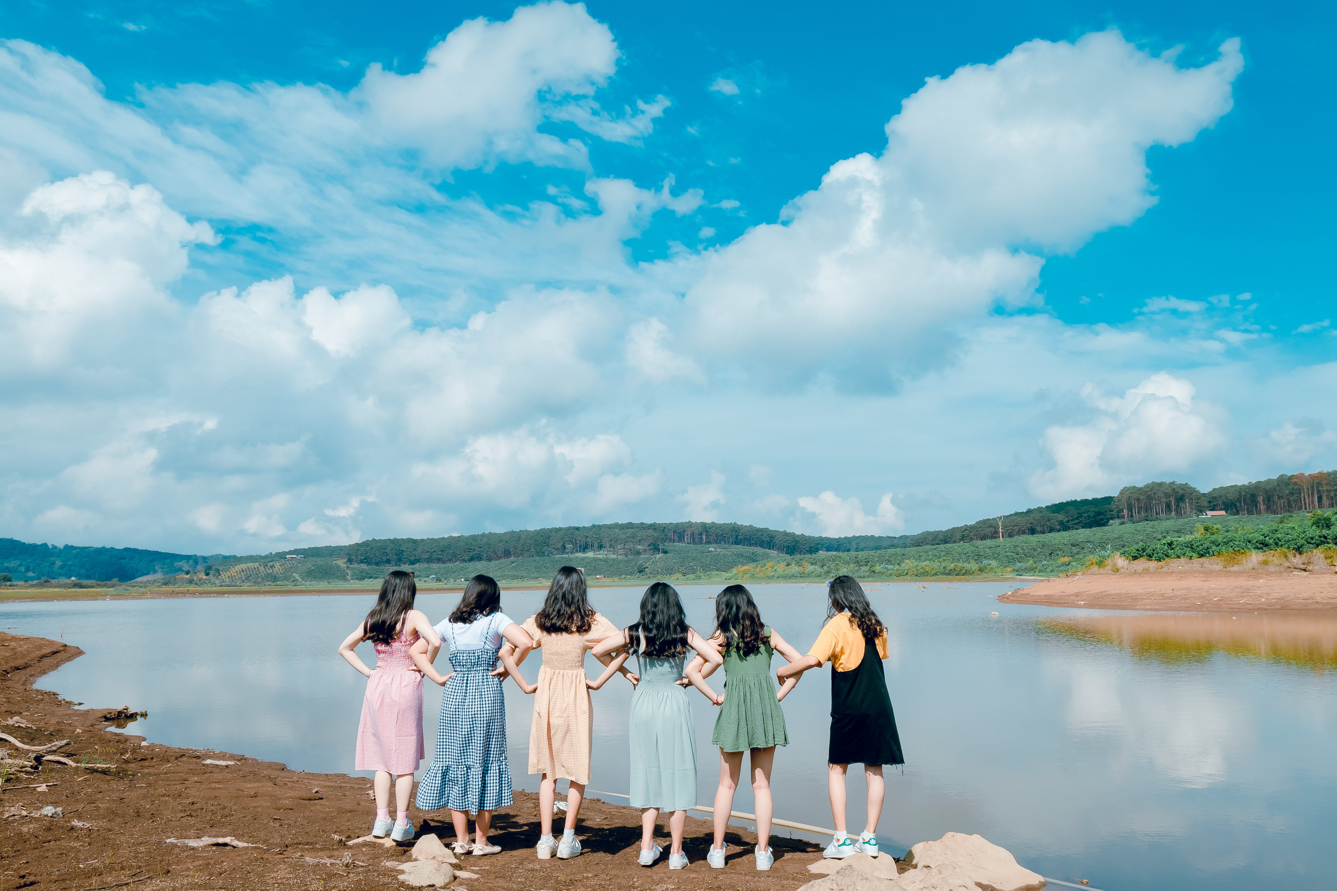 Group of Girls Standing Beside River