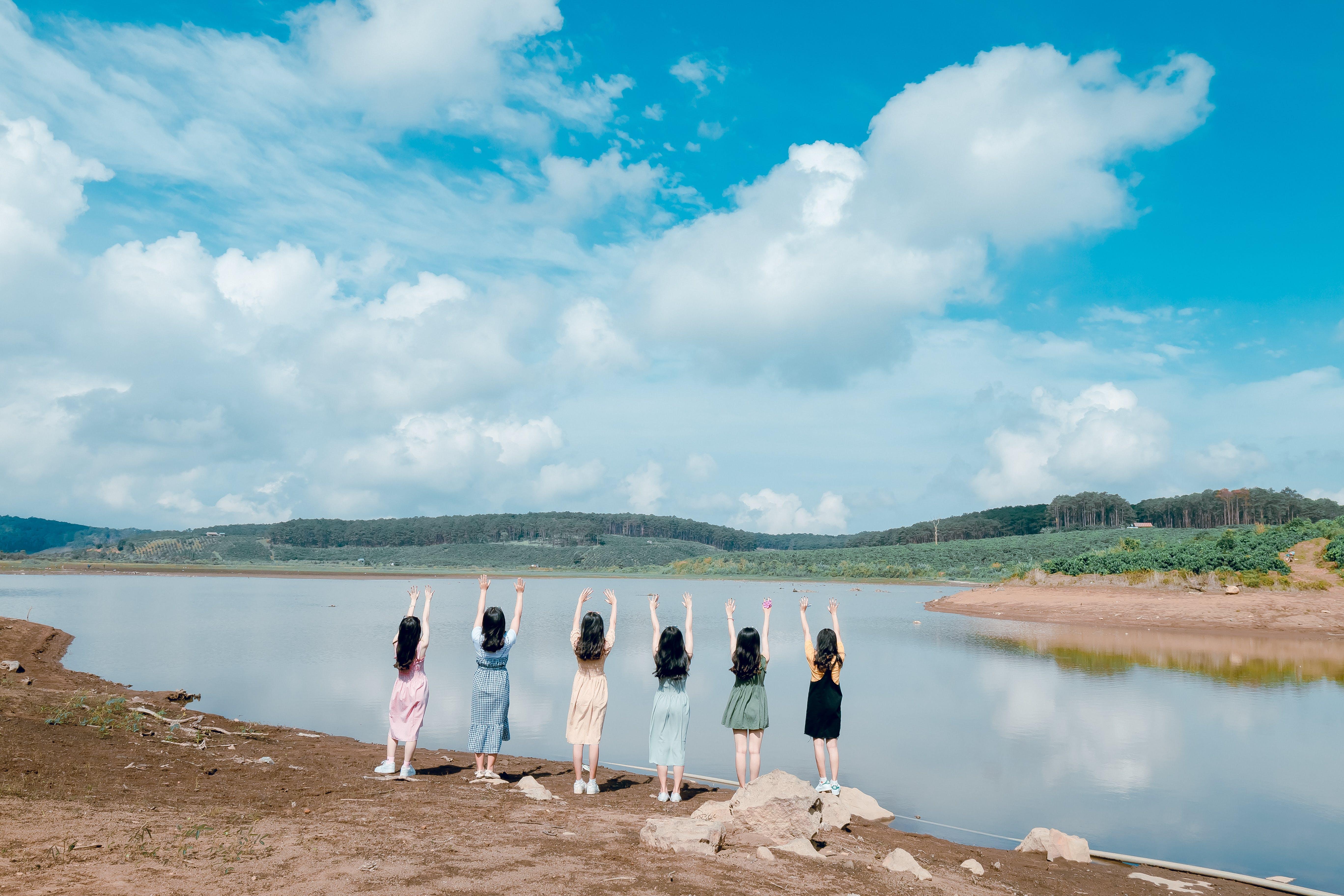 Six Women Raising Their Both Hands